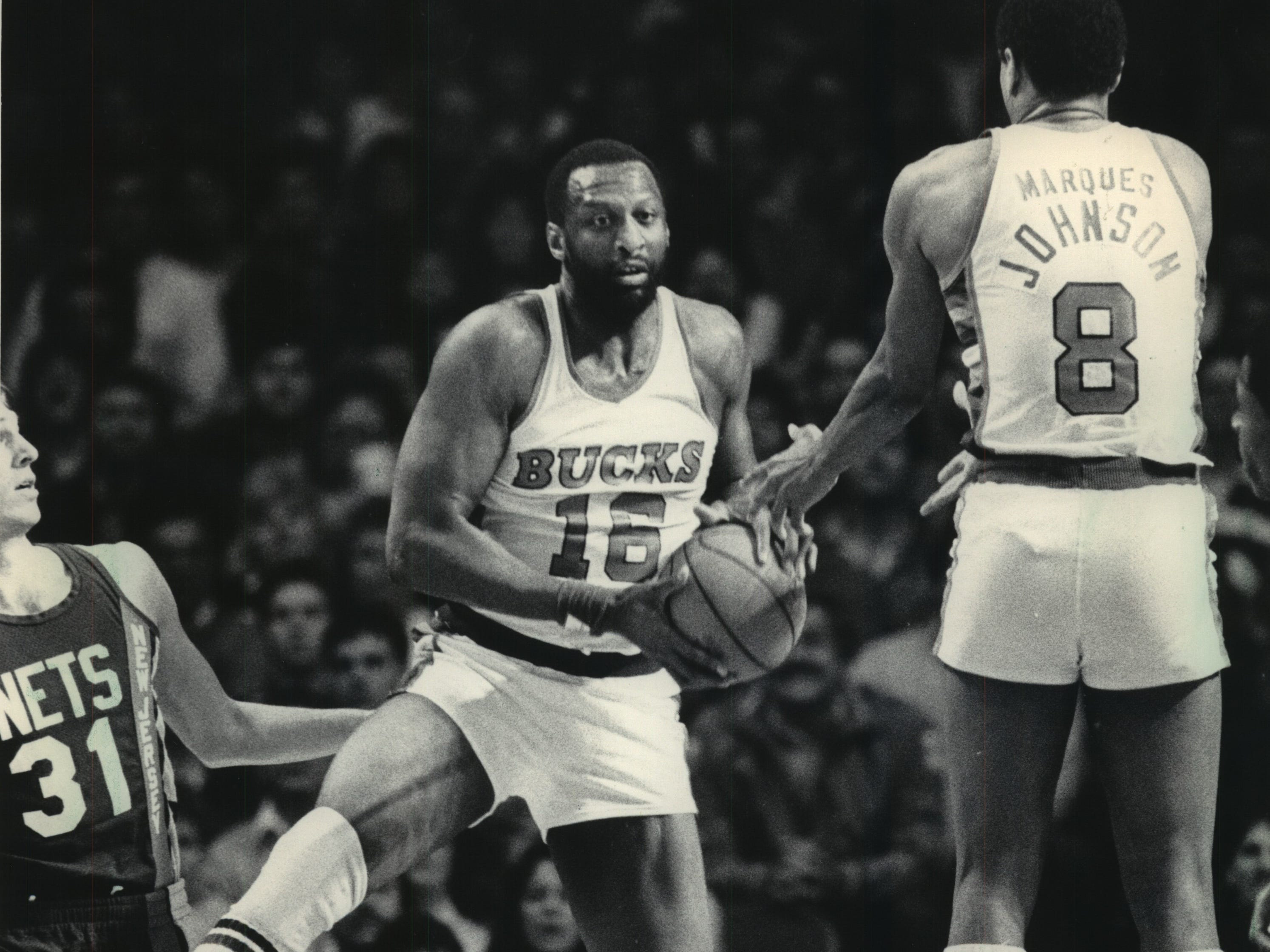 1984: Bob Lanier (center) and Marques Johnson go up for a rebound during Game 1 of the Eastern Conference Semifinals against the New Jersey Nets at the Milwaukee Arena on April 29, 1984. The Nets won the game, 106-100, but the Bucks took the series in six games. Milwaukee then lost the conference finals to the Boston Celtics. This photo was published in the April 30, 1984, Milwaukee Sentinel.