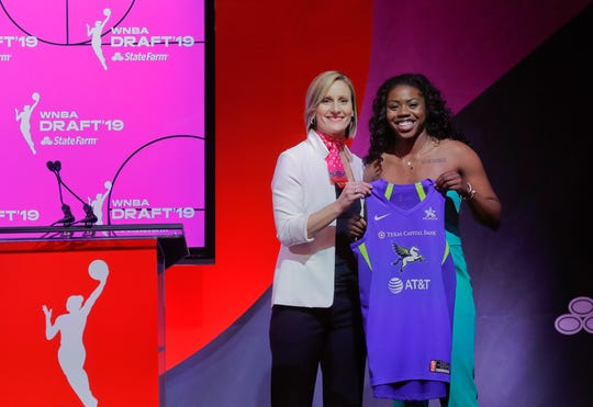 Notre Dame's Arike Ogunbowale (right) poses for a photo with WNBA COO Christy Hedgpeth after being selected by the Dallas Wings as the fifth overall pick in the WNBA draft.