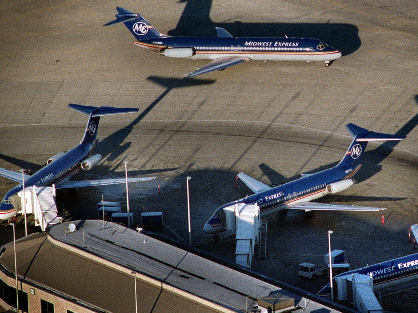Midwest Express planes dock and arrive in the late afternoon Friday at Mitchell International Field.