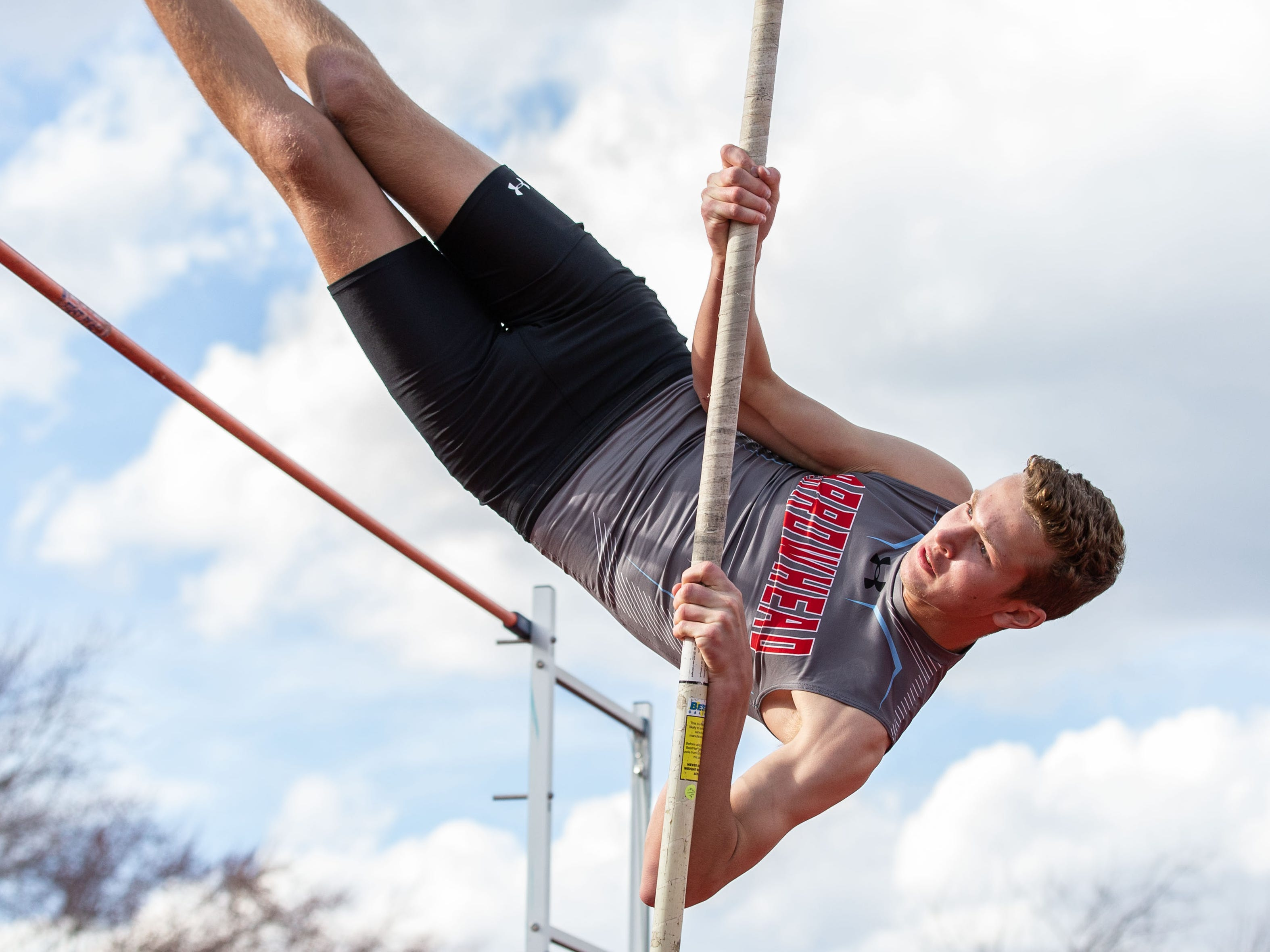 Arrowhead's Grayson Adams competes in the pole vault during the Mike Gain 50th Annual Spartan Invitational at Brookfield East on Tuesday, April 9, 2019.