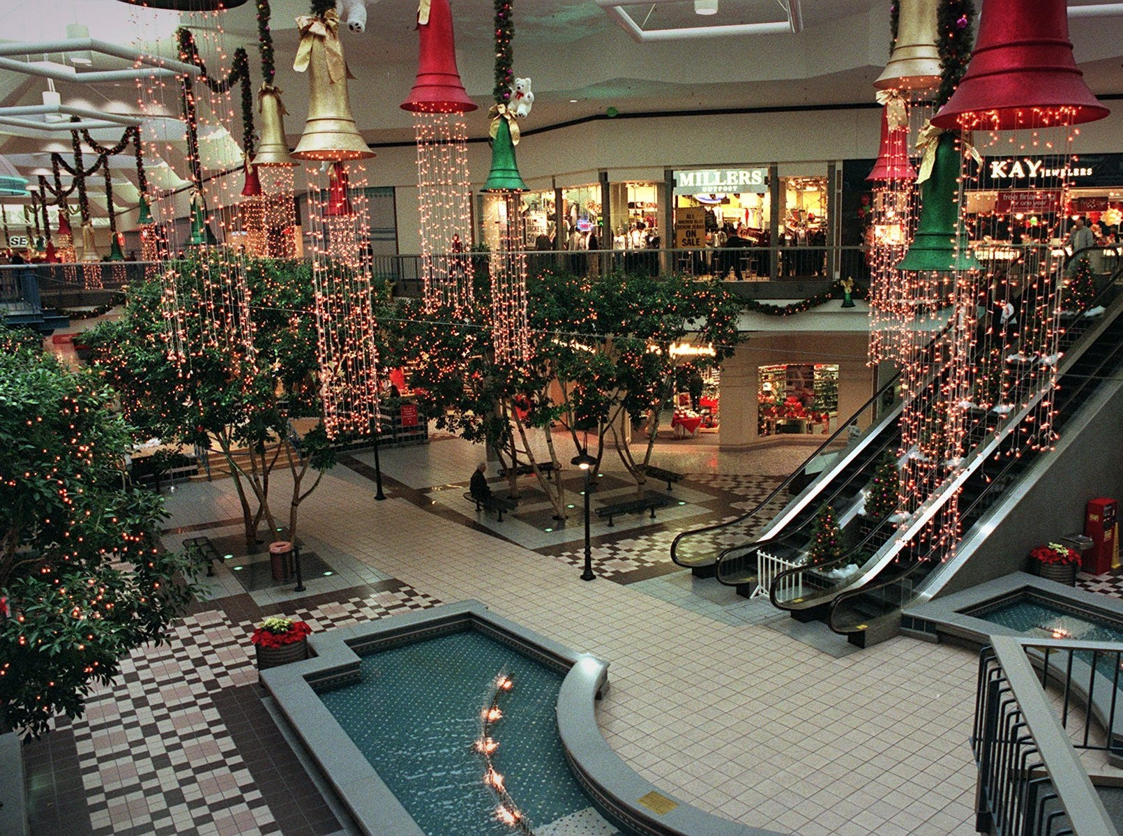 December 1999: Colorful Christmas lights adorn shops in Northridge Mall as they try to lure afternoon shoppers. The appraised value of the mall has plummeted to less than $30 million.