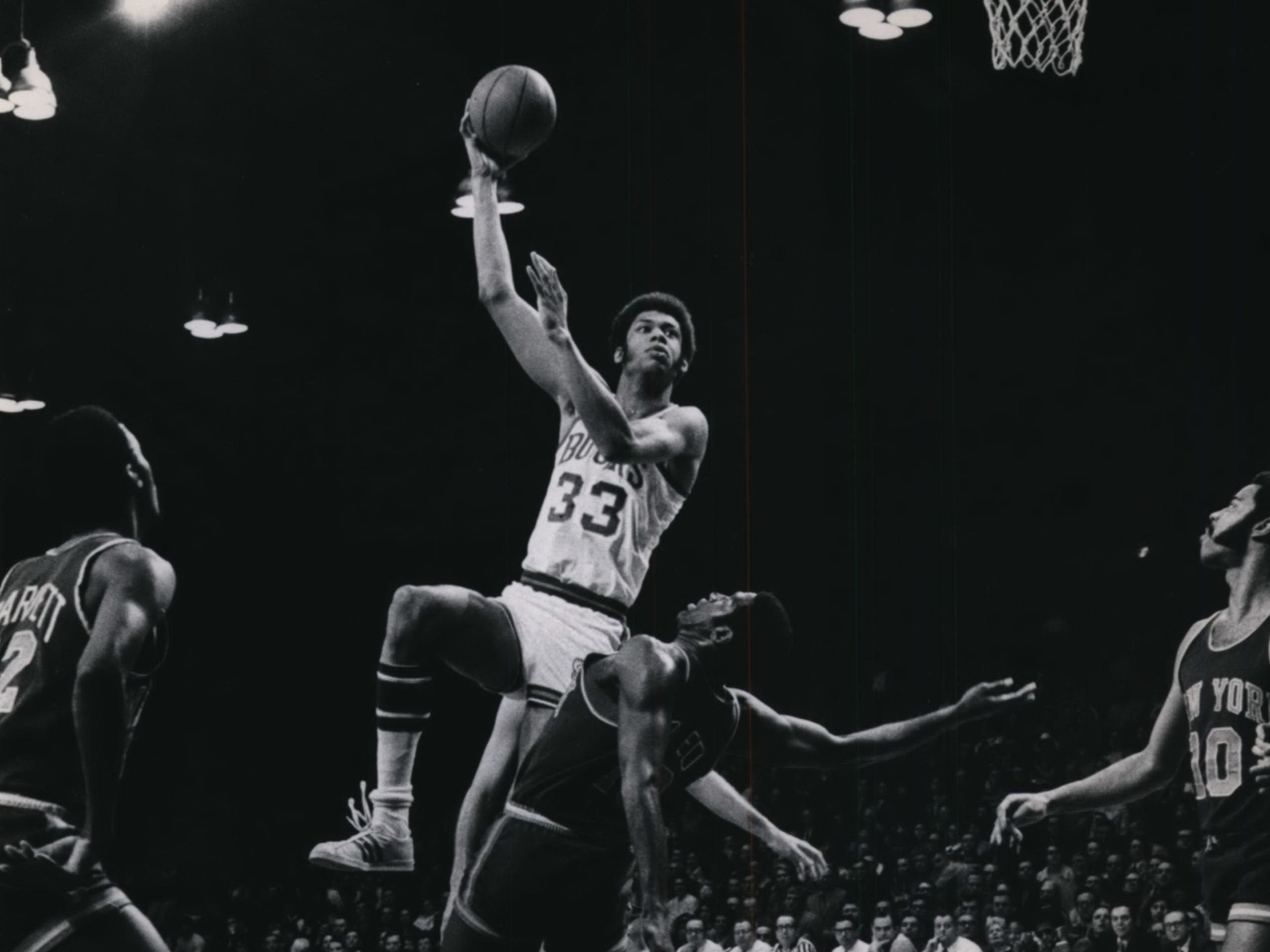 1970: Bucks center Lew Alcindor (later known as Kareem Abdul-Jabbar) fires of his trademark sky hook as the Knicks' Willis Reed tries to convince the refs he's been fouled during Game 4 of the Eastern Conference finals April 19, 1970, at the Milwaukee Arena. The Knicks won the game, 117-105, and the next day won the series. The Bucks, in their first year in the postseason and second year in the league, had beaten the Philadelphia 76ers in the first round of the playoffs. This photo was published in the April 20, 1970, Milwaukee Journal.