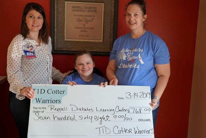 """To raise awareness in her school, Kaylee Ferguson and her mom, Cynthia, designed Type 1 Diabetes Cotter Warriors t-shirts. They sold these shirts to be worn at the first Type 1 Diabetes Awareness """"Blue Out"""" Cotter Basketball game on Jan.24.Pictured are: (from left) Jodi Bodenhamer, RN, CDE, RDLC Coordinator; Kaylee Ferguson, T1D Cotter Warriors Student; and Cynthia Ferguson, Kaylee's mother.The event was created and organized by a Kaylee and a group of other Cotter students. They not only wanted to raise awareness, but to also help support the Reppell Diabetes Learning Center. Kaylee and Cynthia presented a donation from proceeds of the t-shirt sales of $768 to the RDLC in March. Thank you, T1D Cotter Warriors!"""
