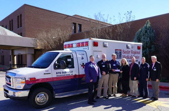 Employees of Air Evac 012 recently presented a check for $1,500 to the Baxter Regional Hospital Foundation in support of their efforts to raise funds for the purchase of new ambulances for Baxter Regional Medical Center Ambulance Services department. Pictured are: (from left) are David Fox, Baxter Regional VP/Chief Operating Officer; Christopher Fry, EMT-P, Supervisor, Baxter Regional Ambulance Services; Gerald Cantrell, RN, EMT-P, Director, Baxter Regional Ambulance Services; Lacey Robb, BSN RN, CEN, NREMT, Program Director, Air Evac 012; Justin Woods, CFRE, Gift Officer, Baxter Regional Hospital Foundation; Sam Yoder, RN, Flight Nurse, Air Evac 012 and Barney Larry, BRMC VP/Business Development and Executive Director, Baxter Regional Hospital Foundation. BRMC appreciates our community partners and their support of projects such as this.