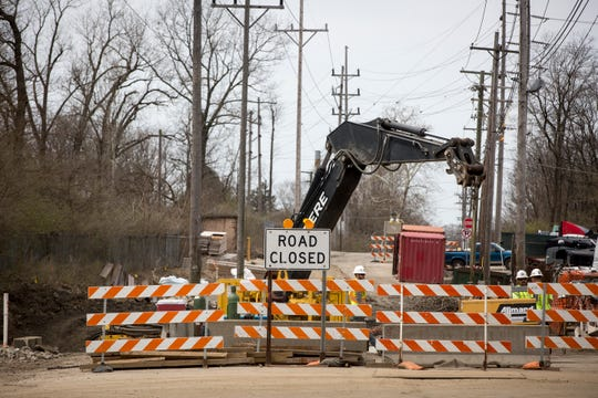 Construction crews begin work on the 23rd Street bridge that takes the road over Buck Creek. The bridge project has been delayed after the project was changed from a rehabilitation to a full replacement.