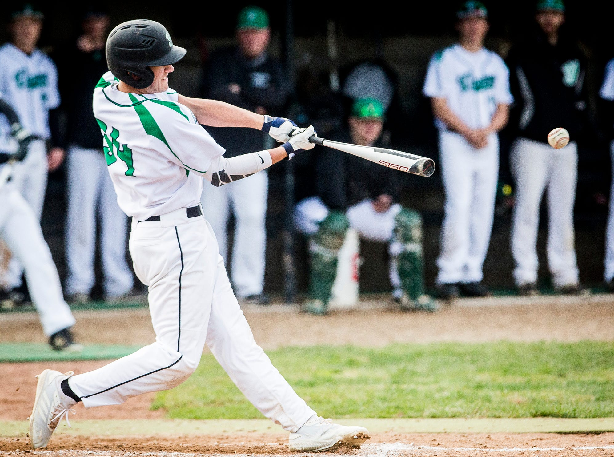 Yorktown's Dominic Cantanzarite hits a pitch from Monroe Central during their game at Yorktown High School Wednesday, April 10, 2019.
