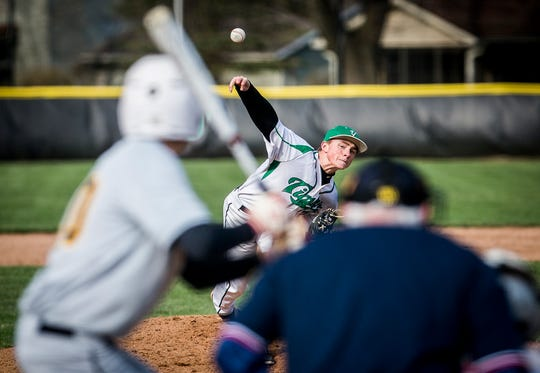 Yorktown's Robby Hook pitches against Monroe Central during their game at Yorktown High School Wednesday, April 10, 2019.