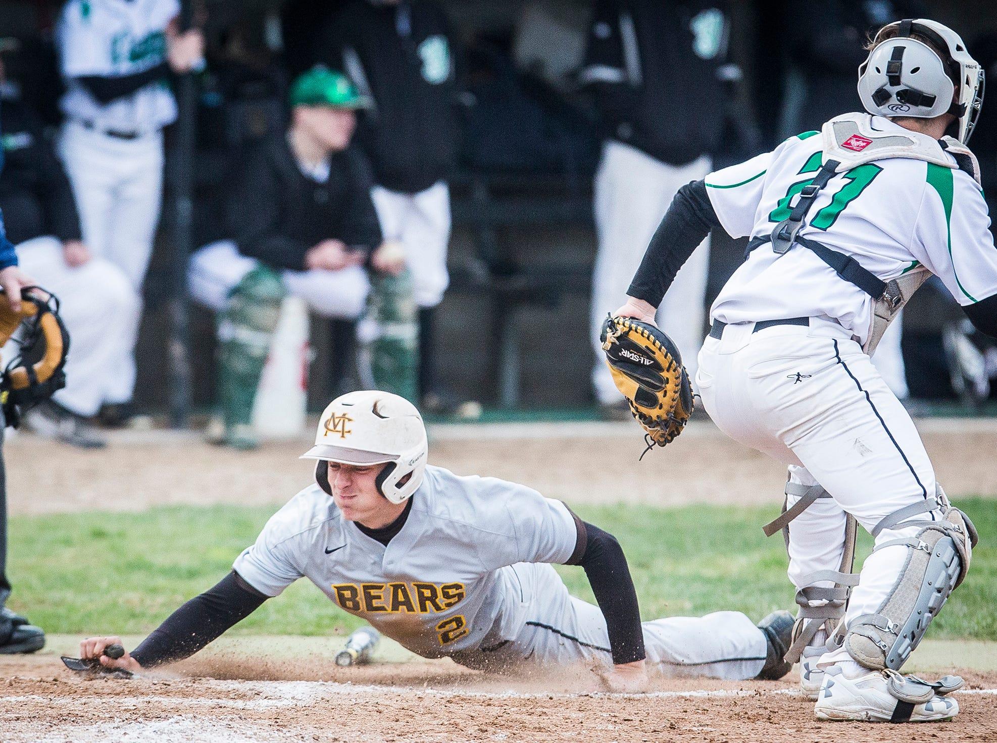 Monroe Central's Seth Wilson slides home against Yorktown during their game at Yorktown High School Wednesday, April 10, 2019.