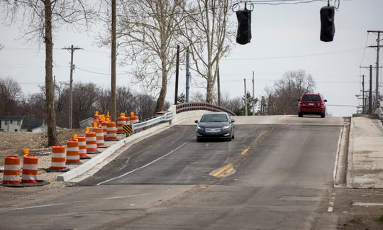Cars in both the eastbound and westbound lanes travel over the East Jackson Street bridge in both directions without the use of the traffic signal in this Star Press photo from April 2019.