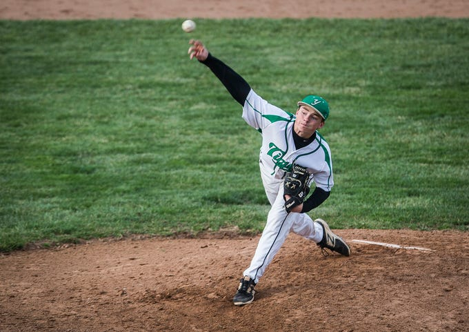 Yorktown's Robby Hook throws against Monroe Central during their game at Yorktown High School Wednesday, April 10, 2019.