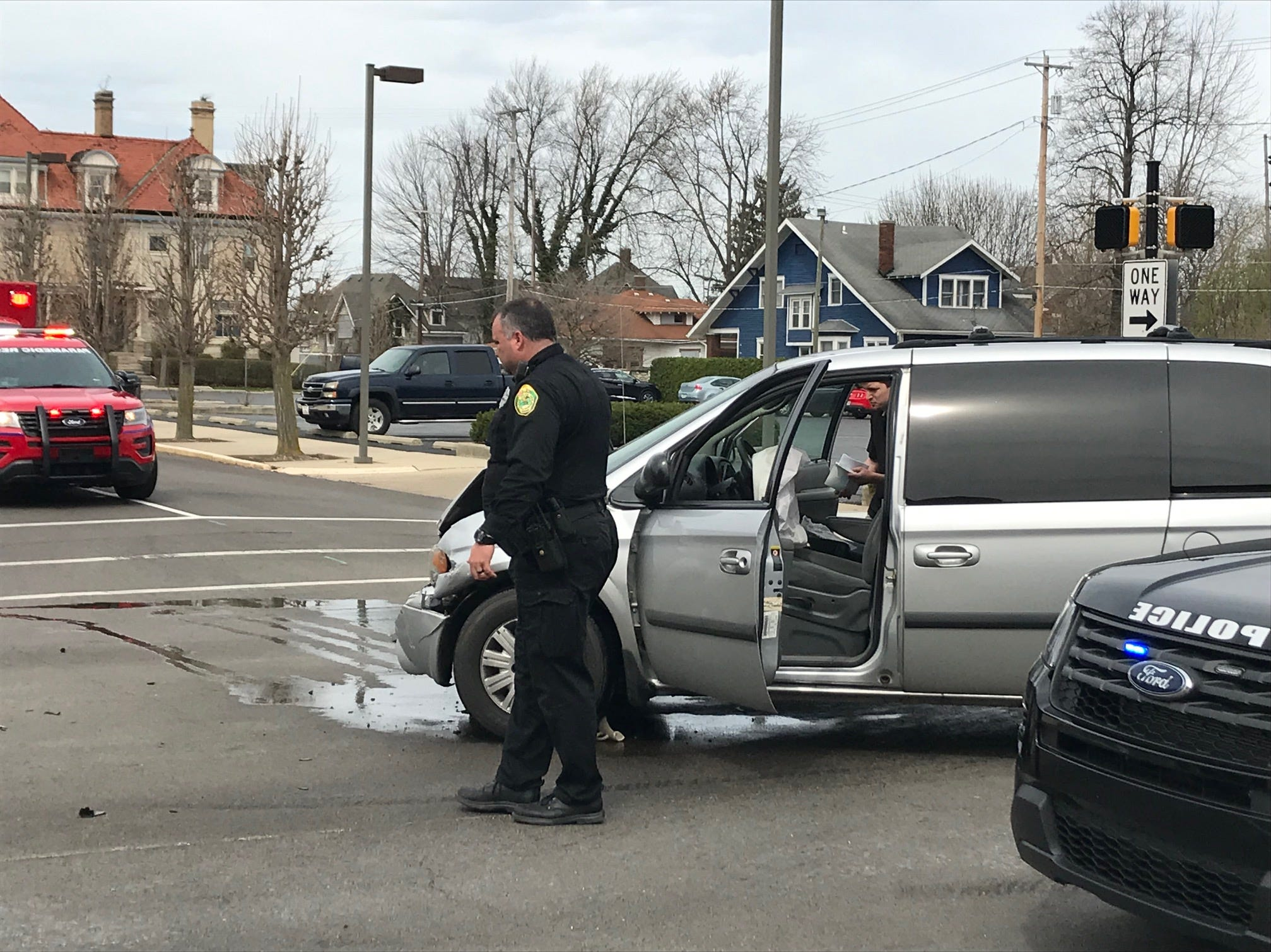 Two people were extricated from their overturned SUV and taken to IU Health Ball Memorial Hospital on Thursday after a two-vehicle collision Thursday at Madison and Washington streets.