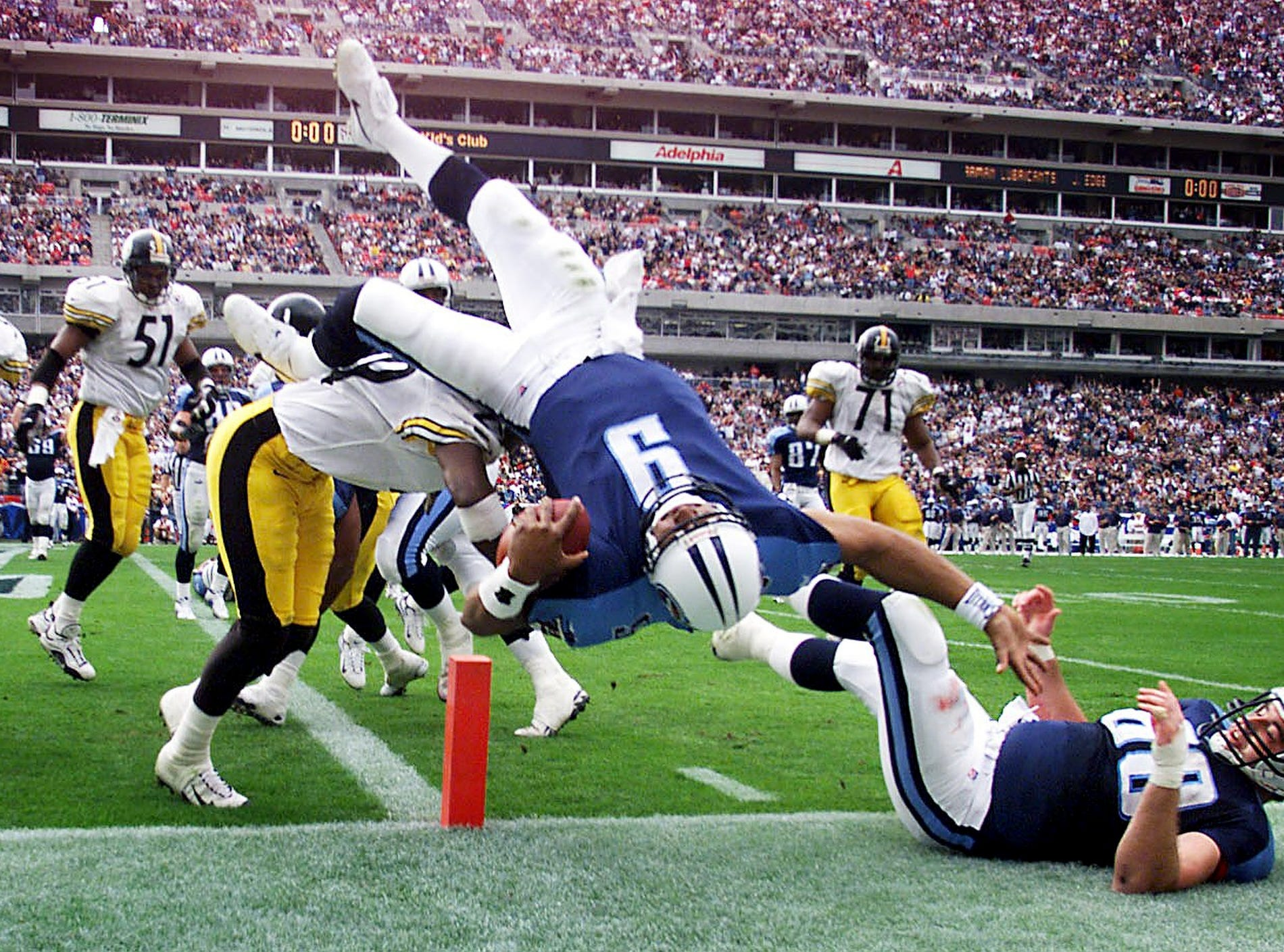 Tennessee Titans quarterback Steve McNair (9) lunges into the end zone at the end of the first quarter against the Pittsburgh Steelers Nov. 21, 1999. The Titans went on to a 16-10 victory at home.