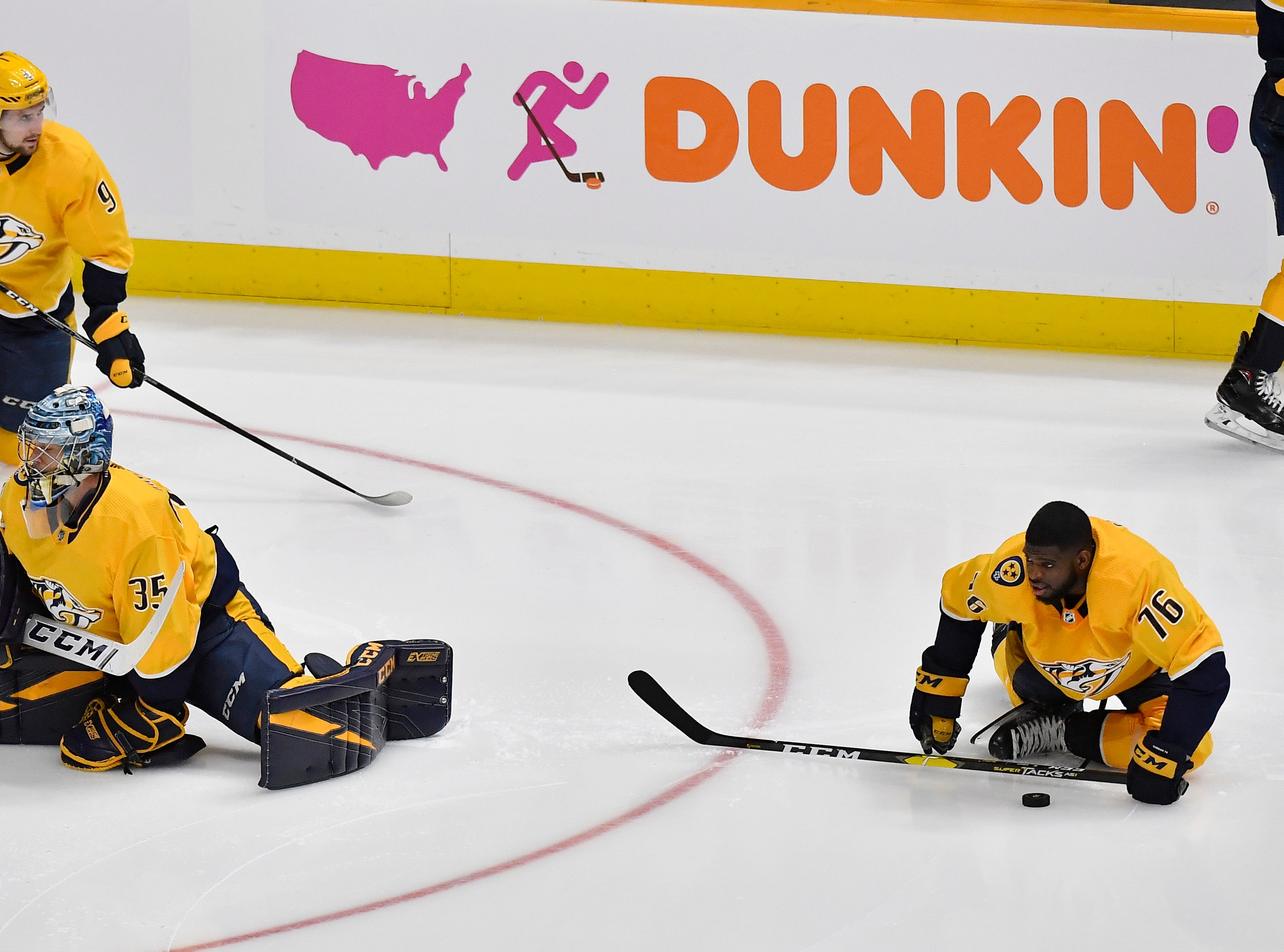 Nashville Predators goaltender Pekka Rinne (35) and defenseman P.K. Subban (76) warm up before the divisional semifinal game against the Dallas Stars at Bridgestone Arena in Nashville, Tenn., Wednesday, April 10, 2019.
