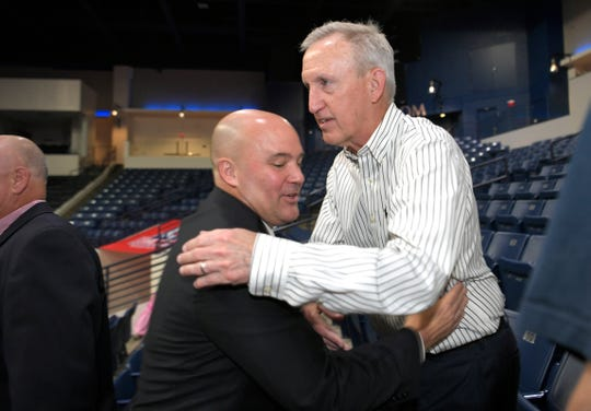Former Belmont coach Rick Byrd, right, hugs Belmont's new coach, Casey Alexander, after a press conference introducing Alexander on Thursday at Curb Event Center.