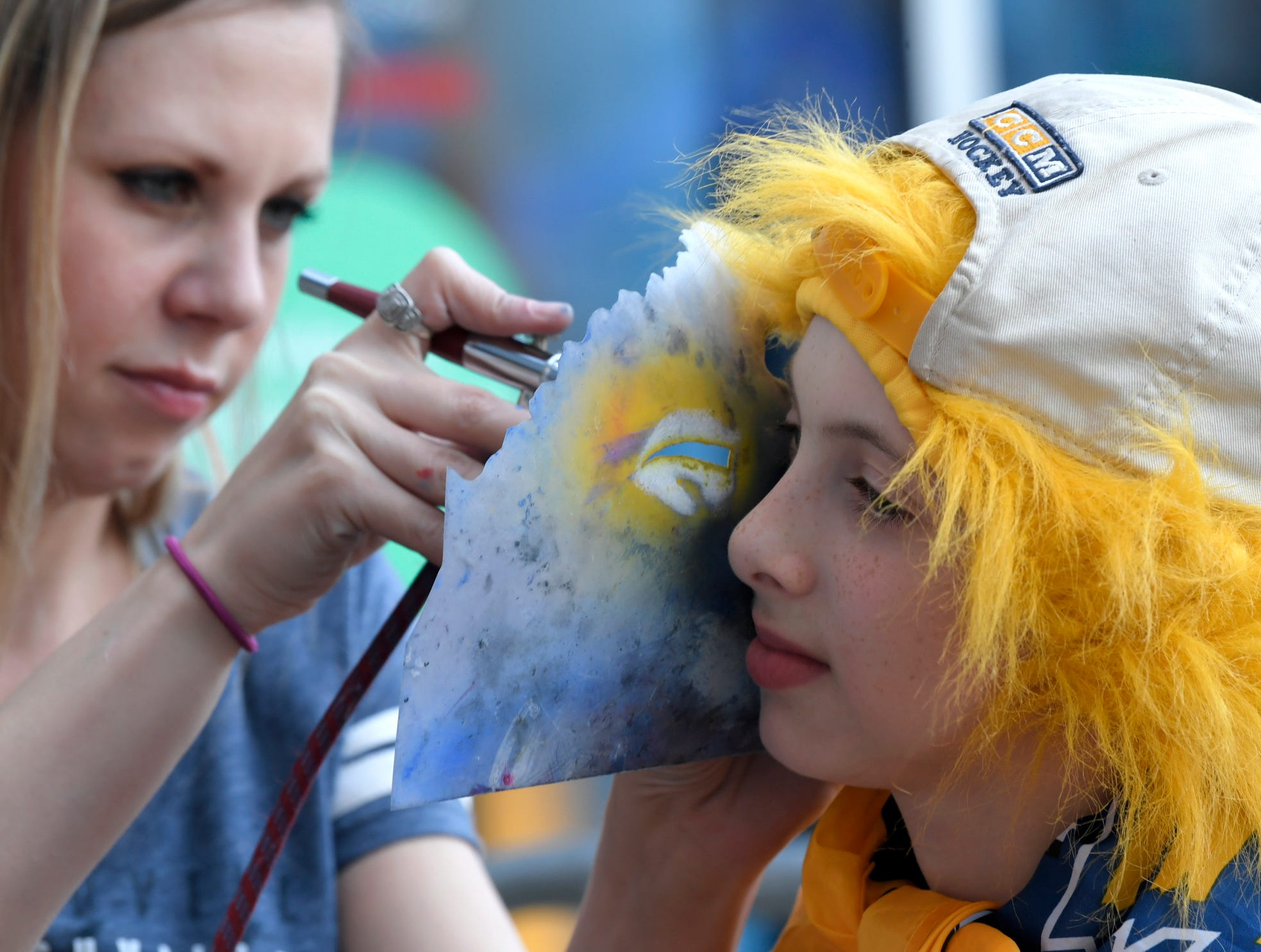 A young Predators fan gets his face painted before the divisional semifinal game at Bridgestone Arena in Nashville, Tenn., Wednesday, April 10, 2019.