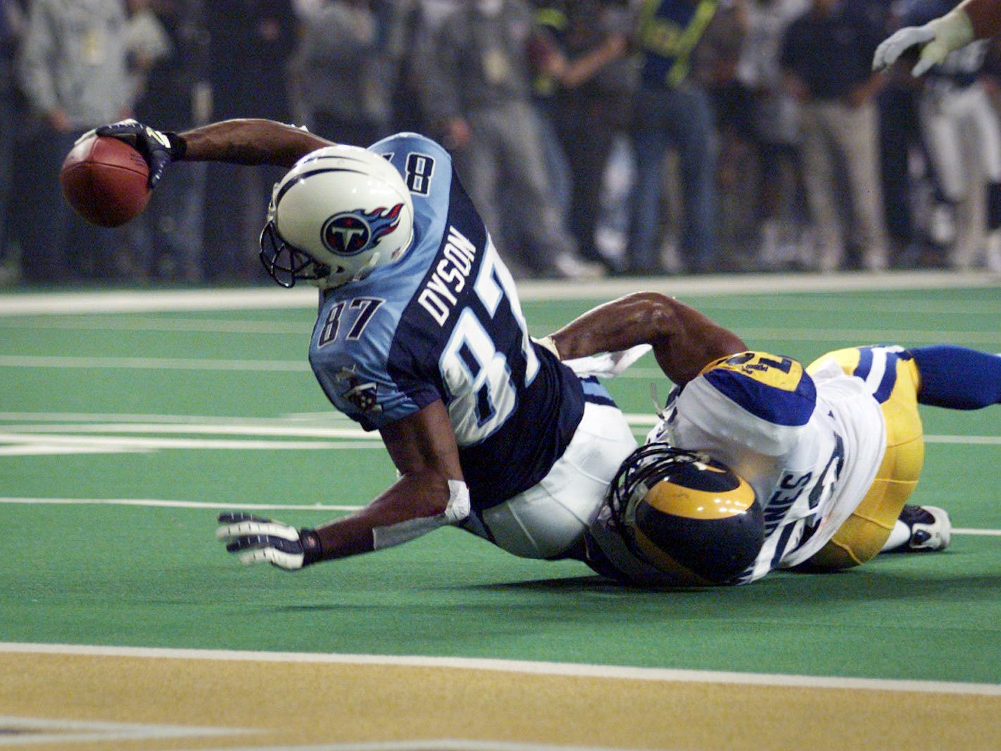 Tennessee Kevin Dyson stretches for the goal in the last play of Super Bowl XXXIV as the Titans try to score a final touchdown but the clock ran out and the St. Louis Rams won 23-16 in Atlanta Jan. 30, 2000.