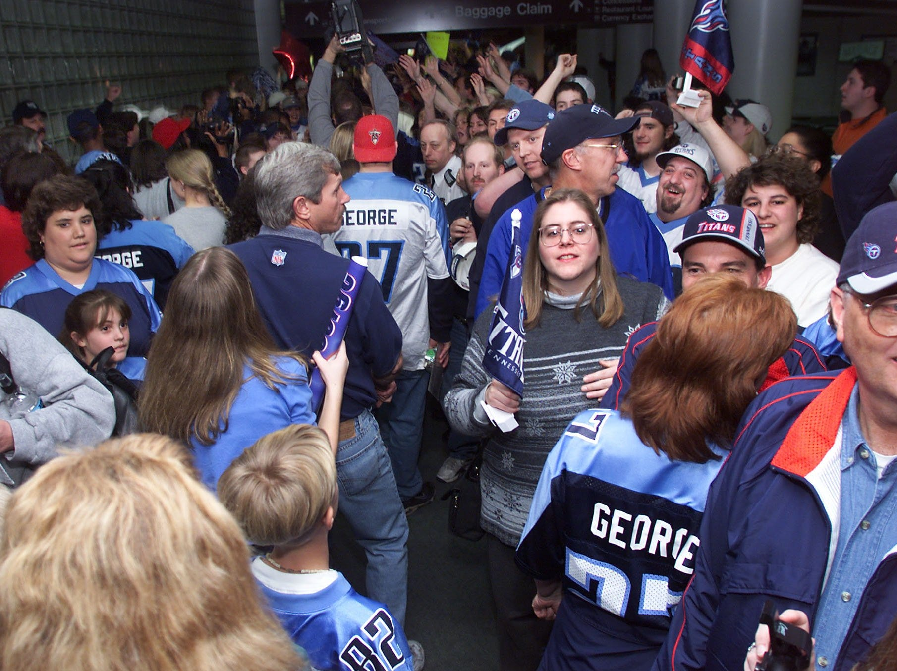 Hundreds out of thousands of Tennessee Titans fans line the corridor at Nashville International Airport Jan. 16, 2000 as the team arrives back after their victory over the Indianapolis Colts in the AFC divisional playoff game in Indianapolis.
