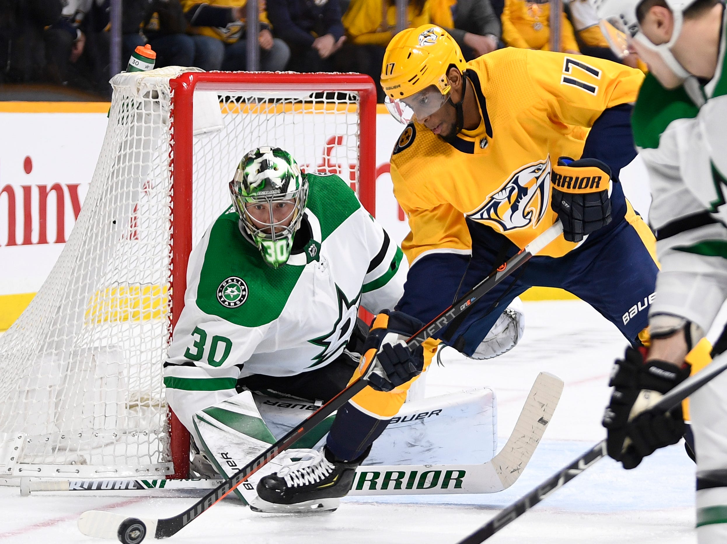 Nashville Predators right wing Wayne Simmonds (17) moves the puck in front of Dallas Stars goaltender Ben Bishop (30) late in the third period of the divisional semifinal game at Bridgestone Arena in Nashville, Tenn., Wednesday, April 10, 2019.