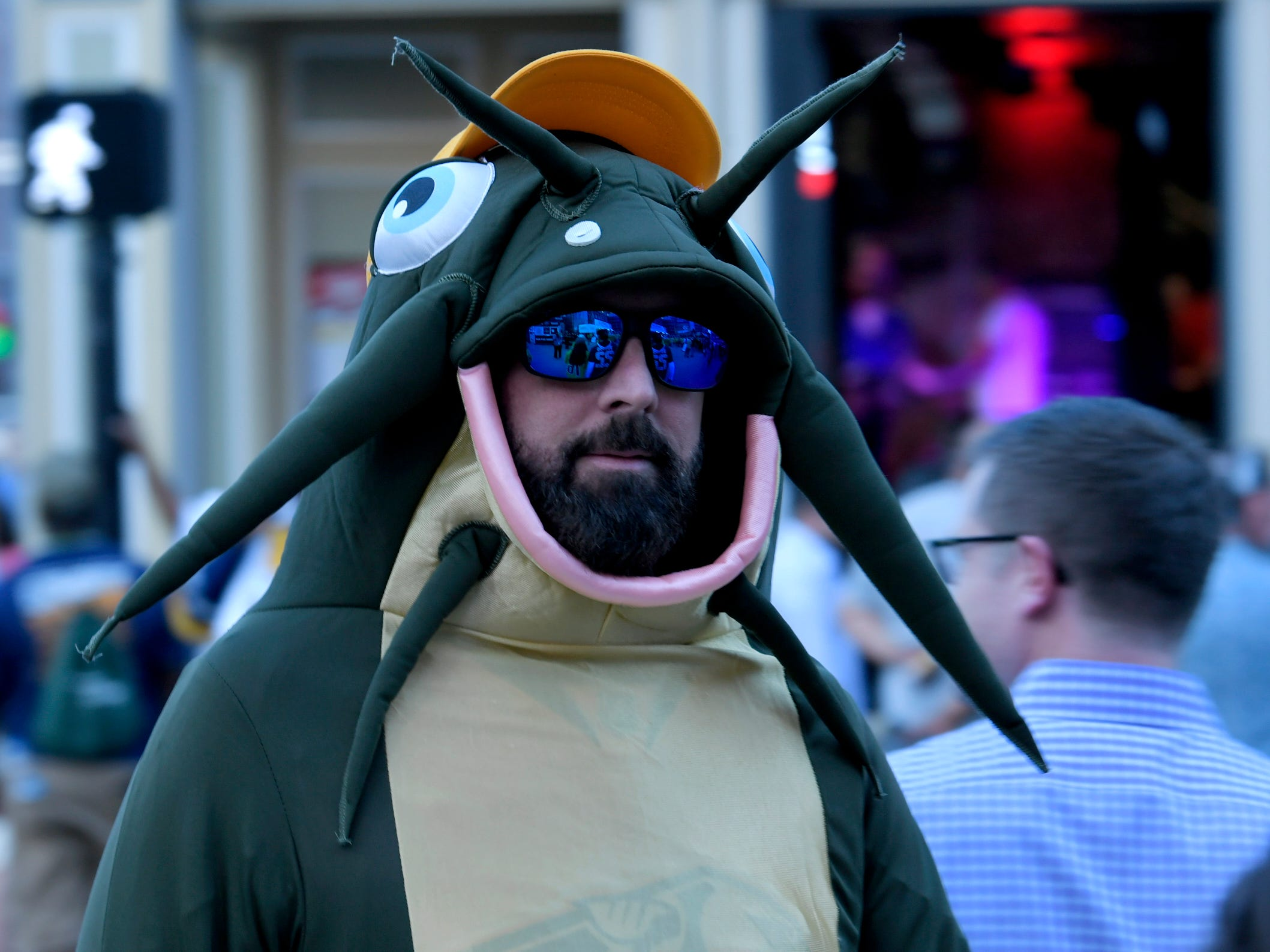 A Predators fan decked out in full catfish costume walks around before the divisional semifinal game at Bridgestone Arena in Nashville, Tenn., Wednesday, April 10, 2019.