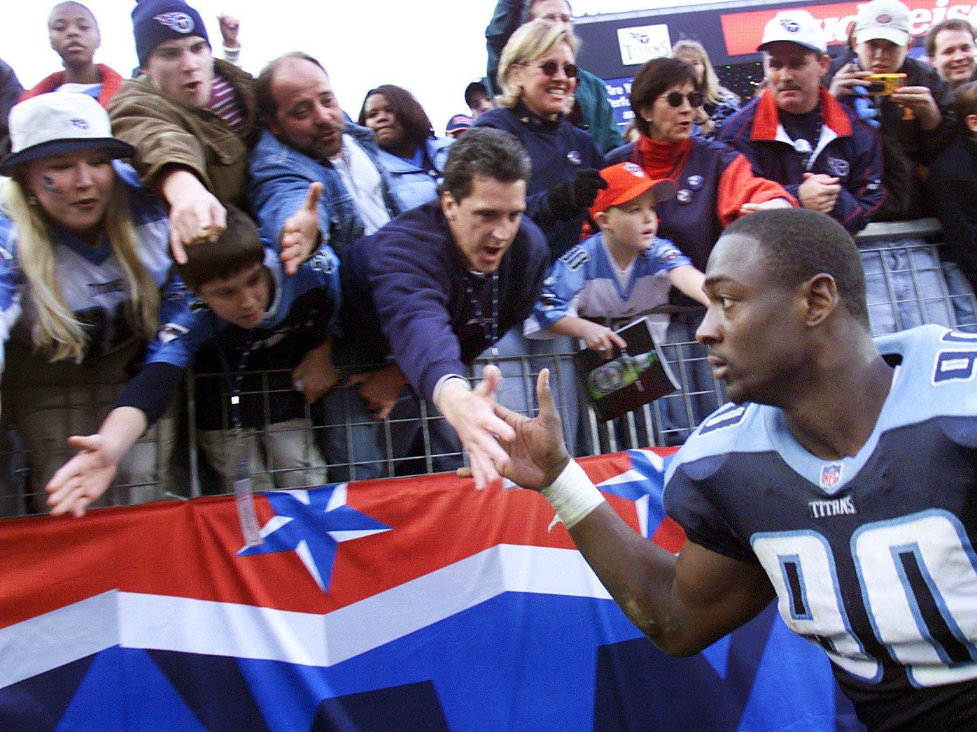 Tennessee Titans star rookie Jevon Kearse shakes hands with the fans after defeating the Atlanta Falcons 30-17 at Adelphia Coliseum Dec. 19, 1999 and insure a playoff berth.