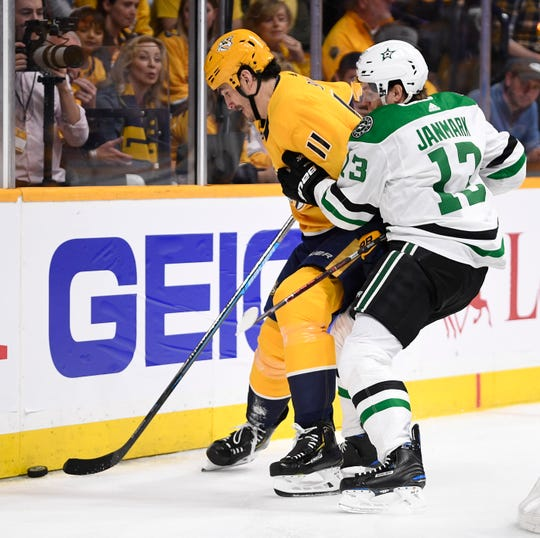 Nashville Predators center Brian Boyle (11) and Dallas Stars center Radek Faksa (12) battle for the puck during the first period of the divisional semifinal game at Bridgestone Arena in Nashville, Tenn., Wednesday, April 10, 2019.