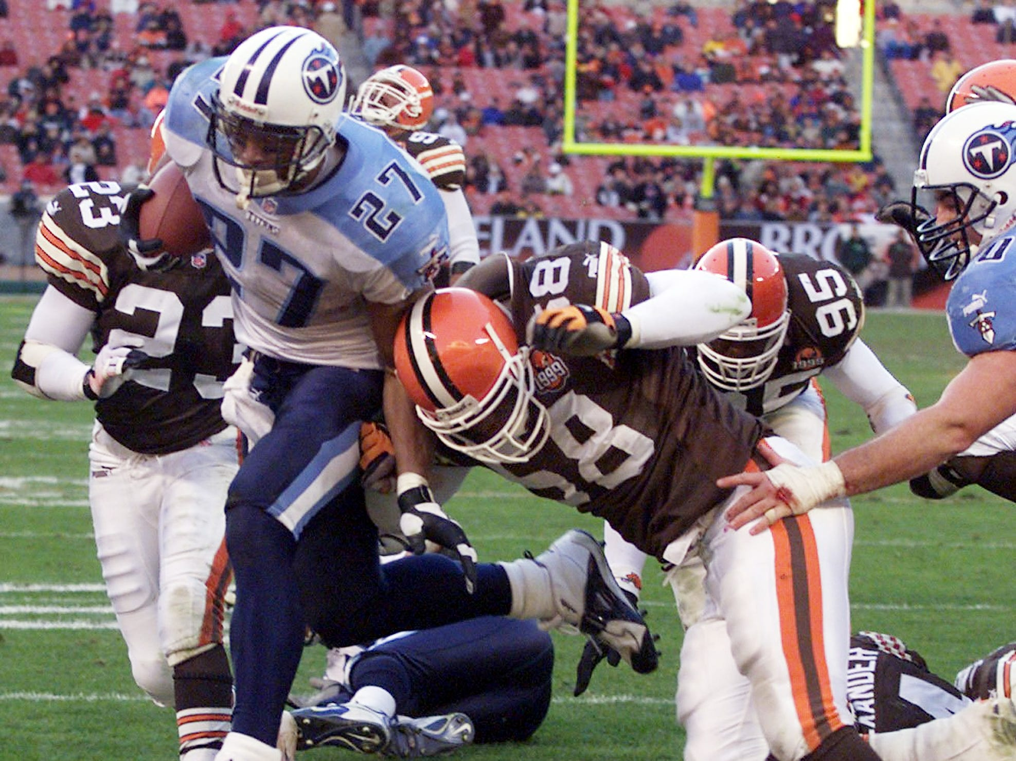 Eddie George (27) of Tennessee Titans rushes into the end zone past Wali Rainer of the Cleveland Browns for a touchdown in the four quarter at Browns Stadium in Cleveland Nov. 28, 1999. Titans went on to a 33-21 victory.