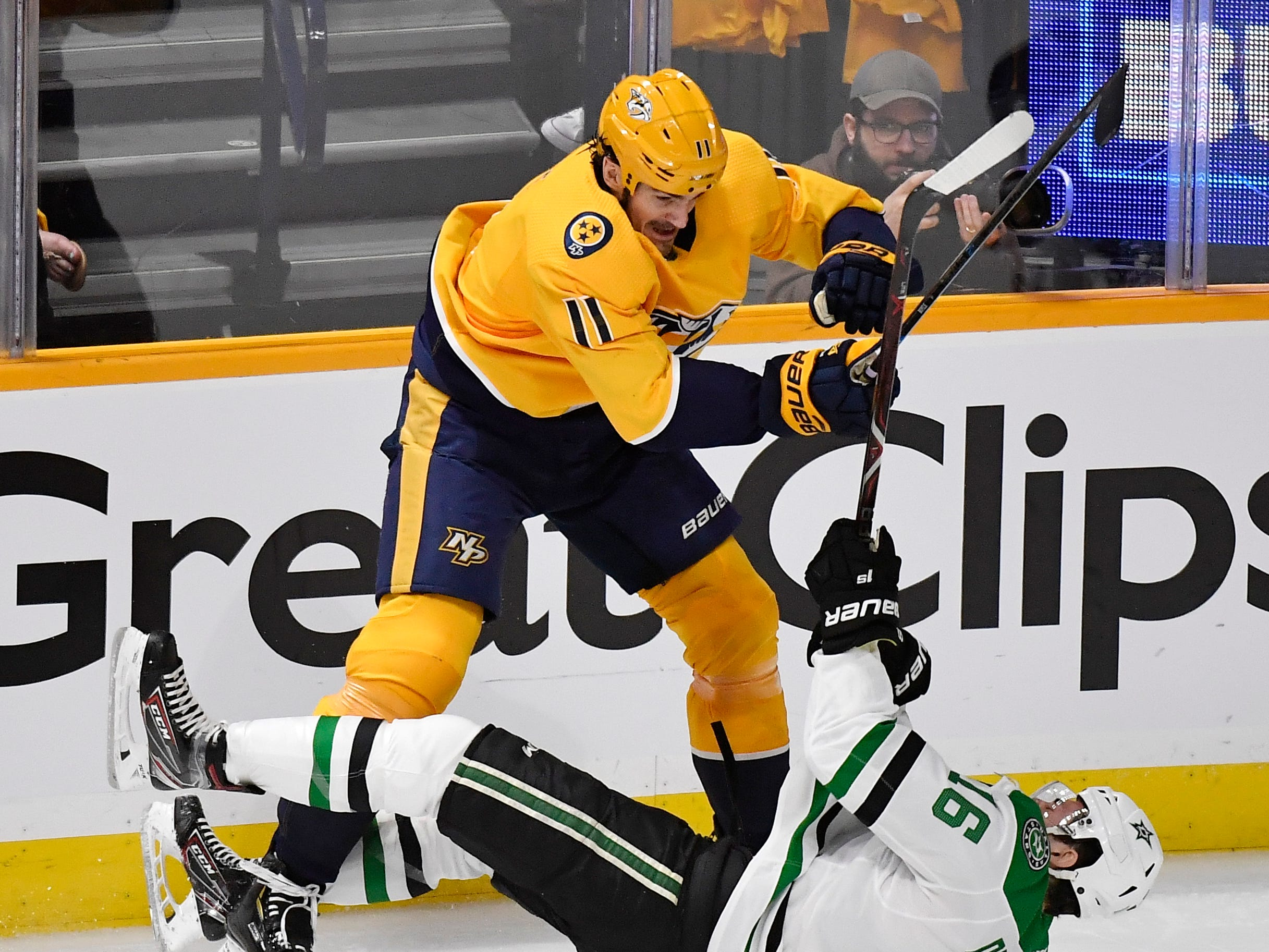 Dallas Stars center Jason Dickinson (16) falls after a hit by Nashville Predators center Brian Boyle (11) during the first period of the divisional semifinal game at Bridgestone Arena in Nashville, Tenn., Wednesday, April 10, 2019.
