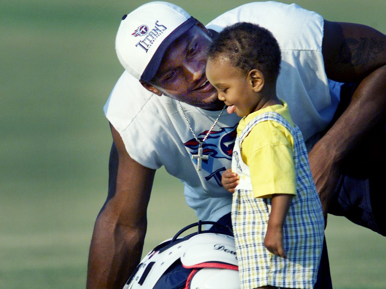 Tennessee Titans quarterback Steve McNair hangs out with his son Tyler, 11-months-old, after practice during training camp in Bellevue Aug. 10, 1999.