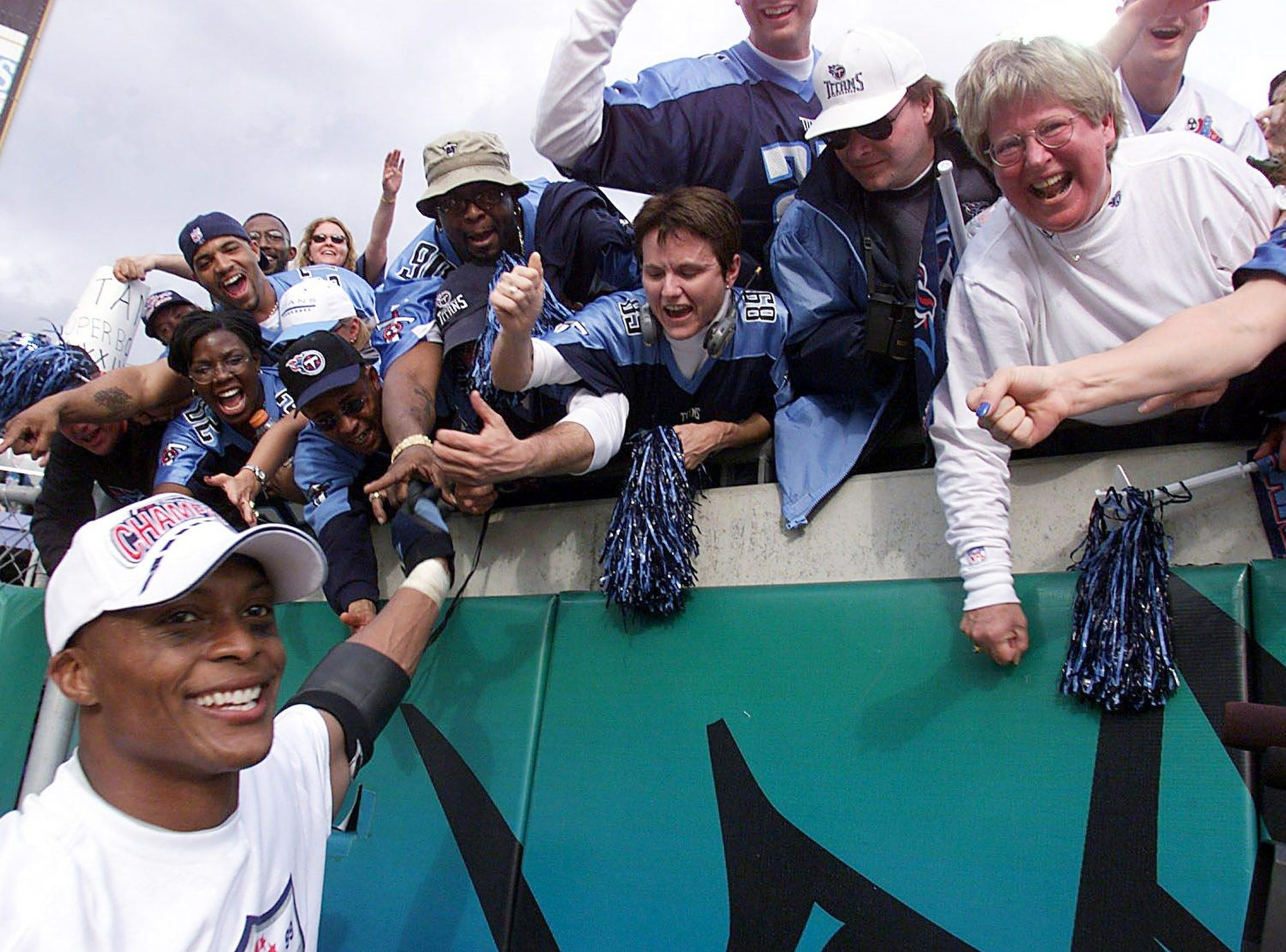 Tennessee Titans running back Eddie George shakes the hands of fans after winning the AFC championship game 33-14 over Jacksonville Jaguars at Alltel Stadium in Jacksonville Jan. 23, 2000.