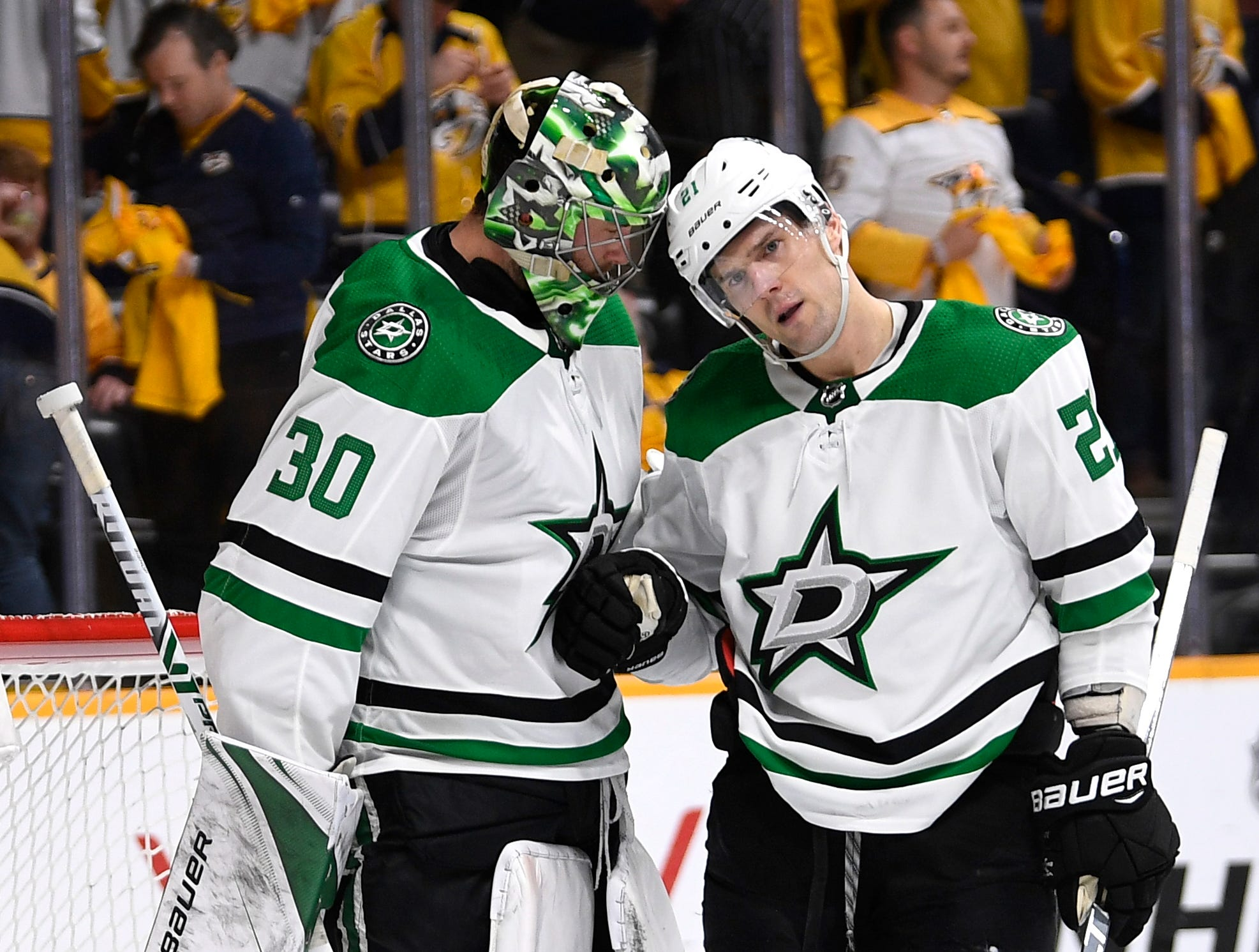 Dallas Stars goaltender Ben Bishop (30) and defenseman Ben Lovejoy (21) celebrate the win over the Nashville Predators in the divisional semifinal game at Bridgestone Arena in Nashville, Tenn., Wednesday, April 10, 2019.