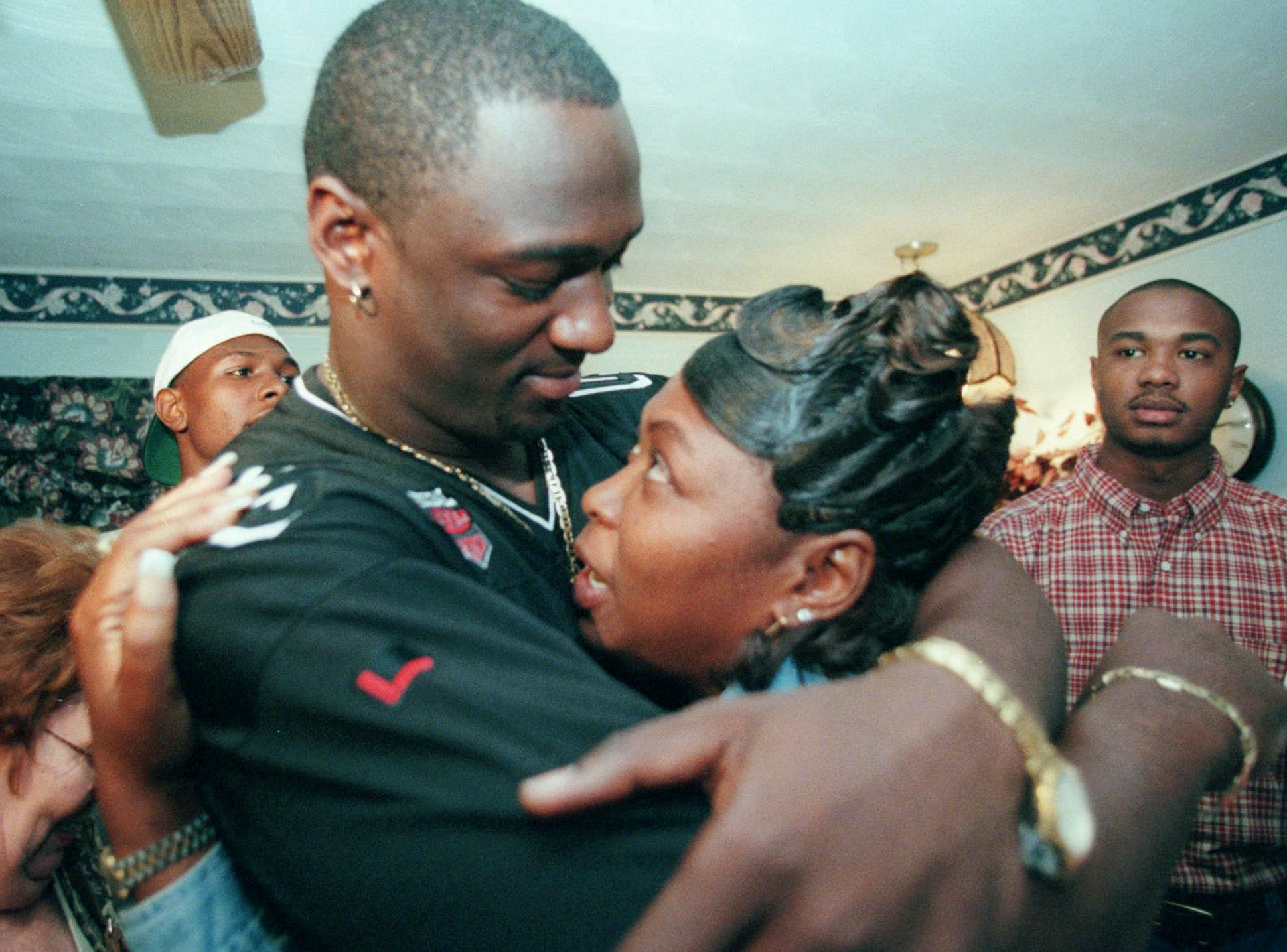 North Fort Myers High School graduate Jevon Kearse, a defensive end for the University of Florida, embraces his mother, Lessie Green, after finding out he was chosen by the Tennessee Titans in the first round of the NFL draft April 17, 1999.