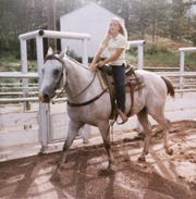 Nine-year-old Dana Perino riding at her grandfather's ranch house arena in Wyoming in 1981