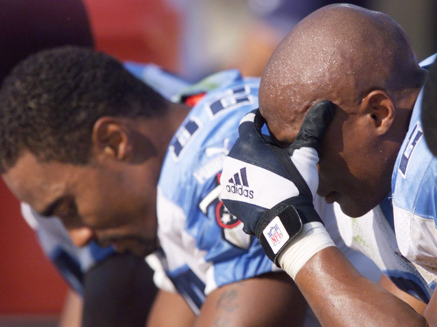 Tennessee Titans running back Eddie George, right, and Yancey Thigpen, left, hang their heads as the clock ticks down in their 24-22 lose against the San Francisco 49ers at Candlestick park in San Francisco Oct. 3, 1999.