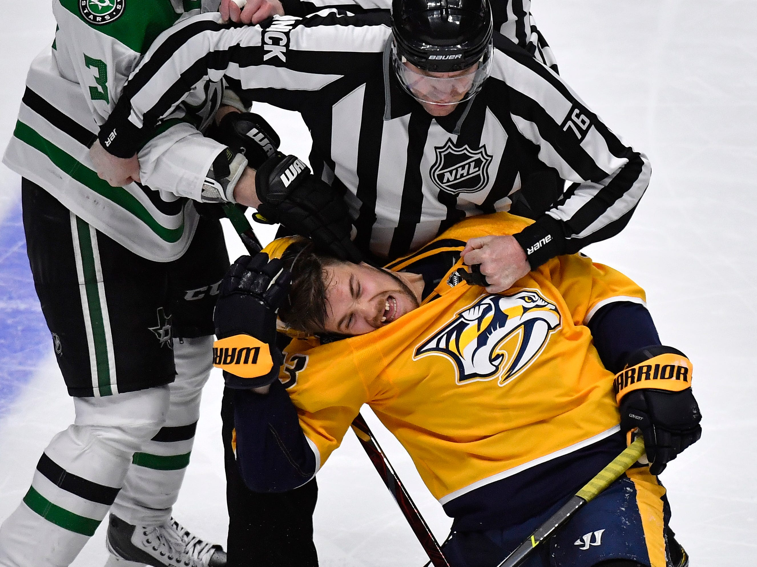 Referees separate Nashville Predators right wing Viktor Arvidsson (33) and Dallas Stars defenseman John Klingberg (3) during a fight in the second period of the divisional semifinal game at Bridgestone Arena in Nashville, Tenn., Wednesday, April 10, 2019.