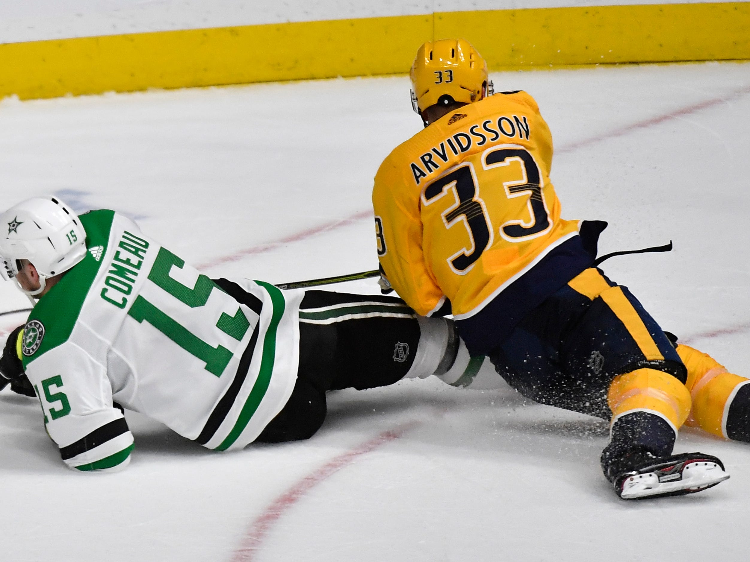 Nashville Predators right wing Viktor Arvidsson (33)  and Dallas Stars left wing Blake Comeau (15) battle for the puck during the third period of the divisional semifinal game at Bridgestone Arena in Nashville, Tenn., Wednesday, April 10, 2019.