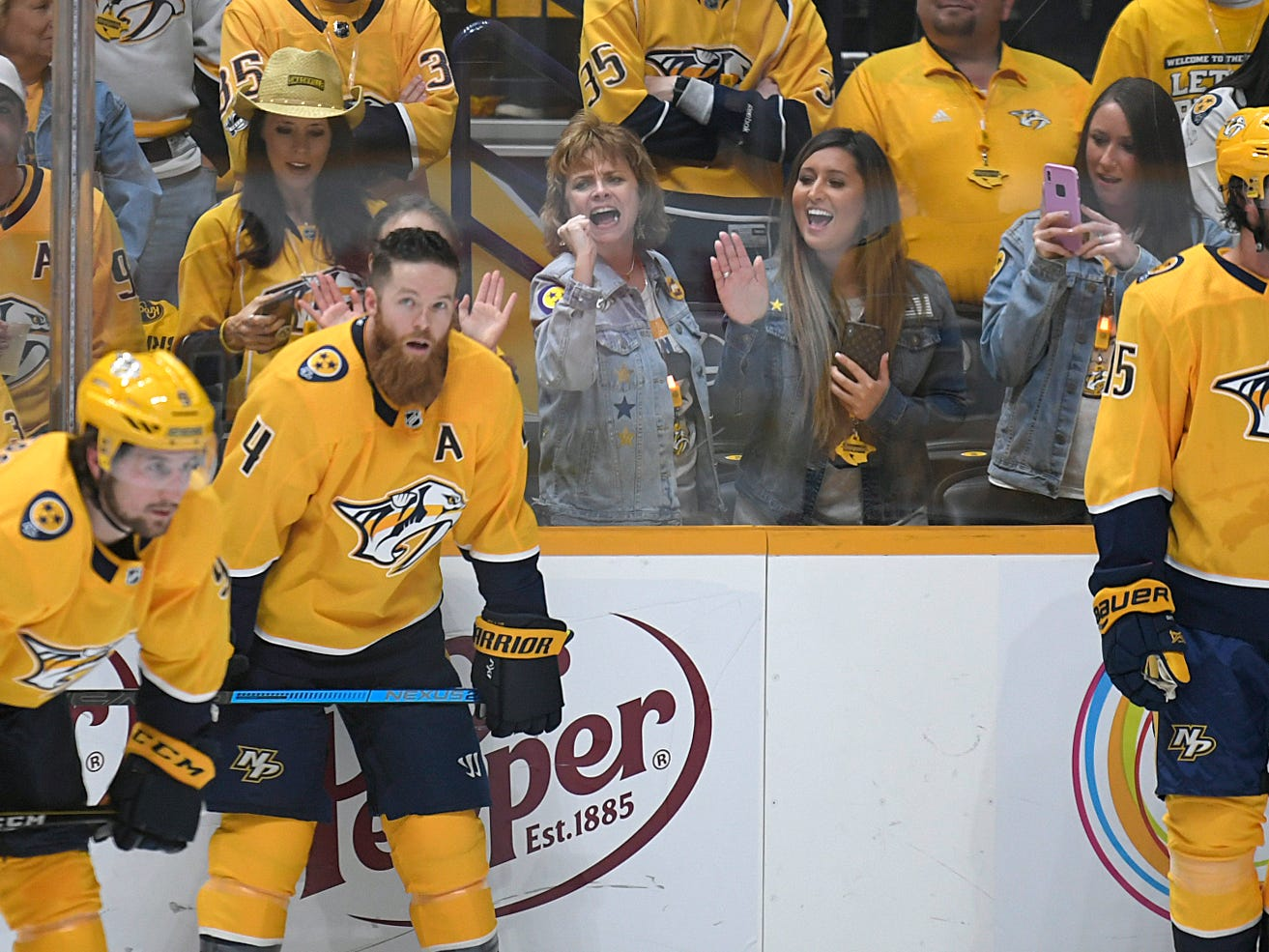 Fans cheer as the Predators take the ice for warm ups during divisional semifinal Stanley Cup playoff game at Bridgestone Arena in Nashville on Wednesday, April 10, 2019.