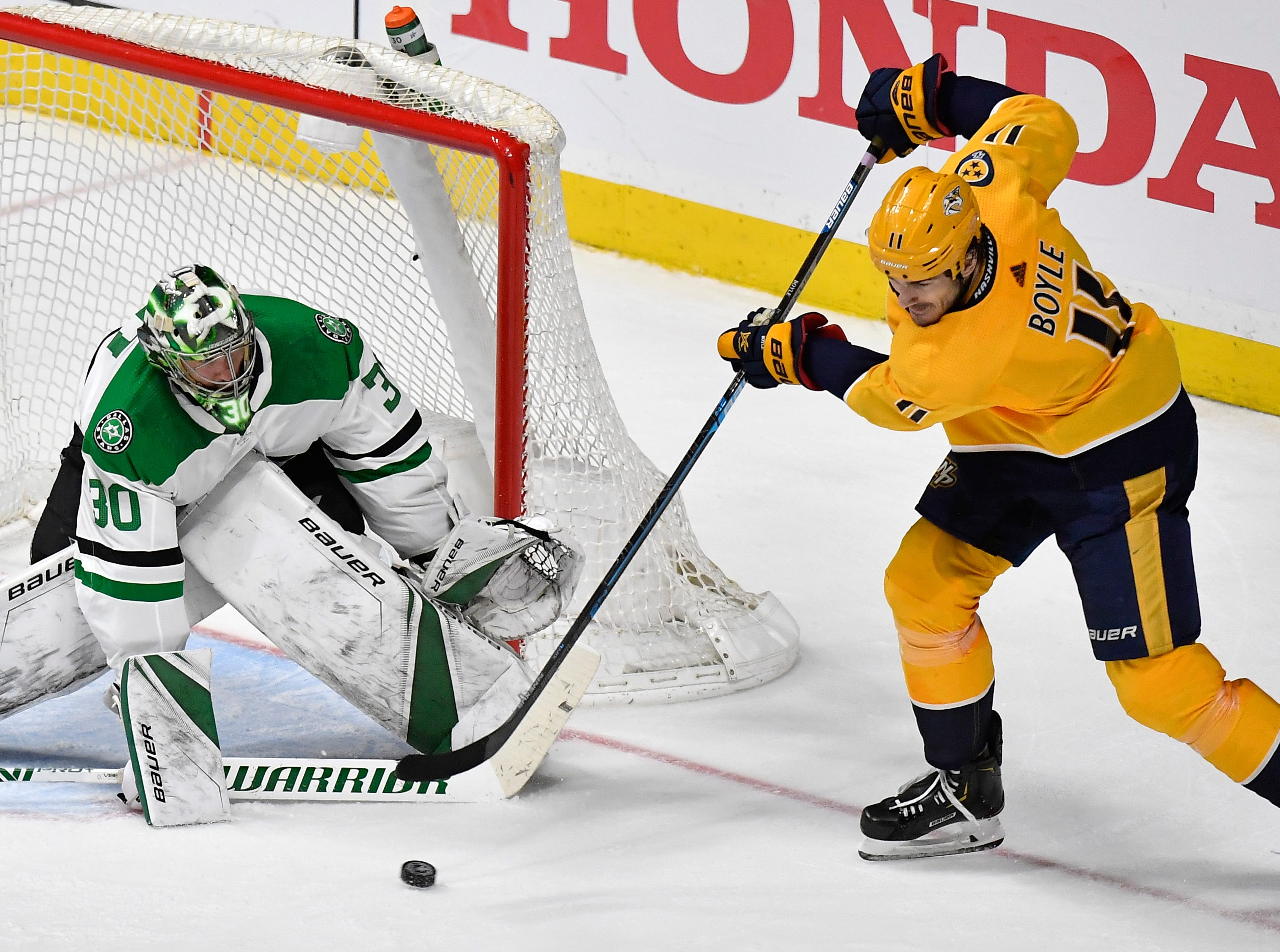 Nashville Predators center Brian Boyle (11) plays the puck in front of Dallas Stars goaltender Ben Bishop (30) during the third period of the divisional semifinal game at Bridgestone Arena in Nashville, Tenn., Wednesday, April 10, 2019.