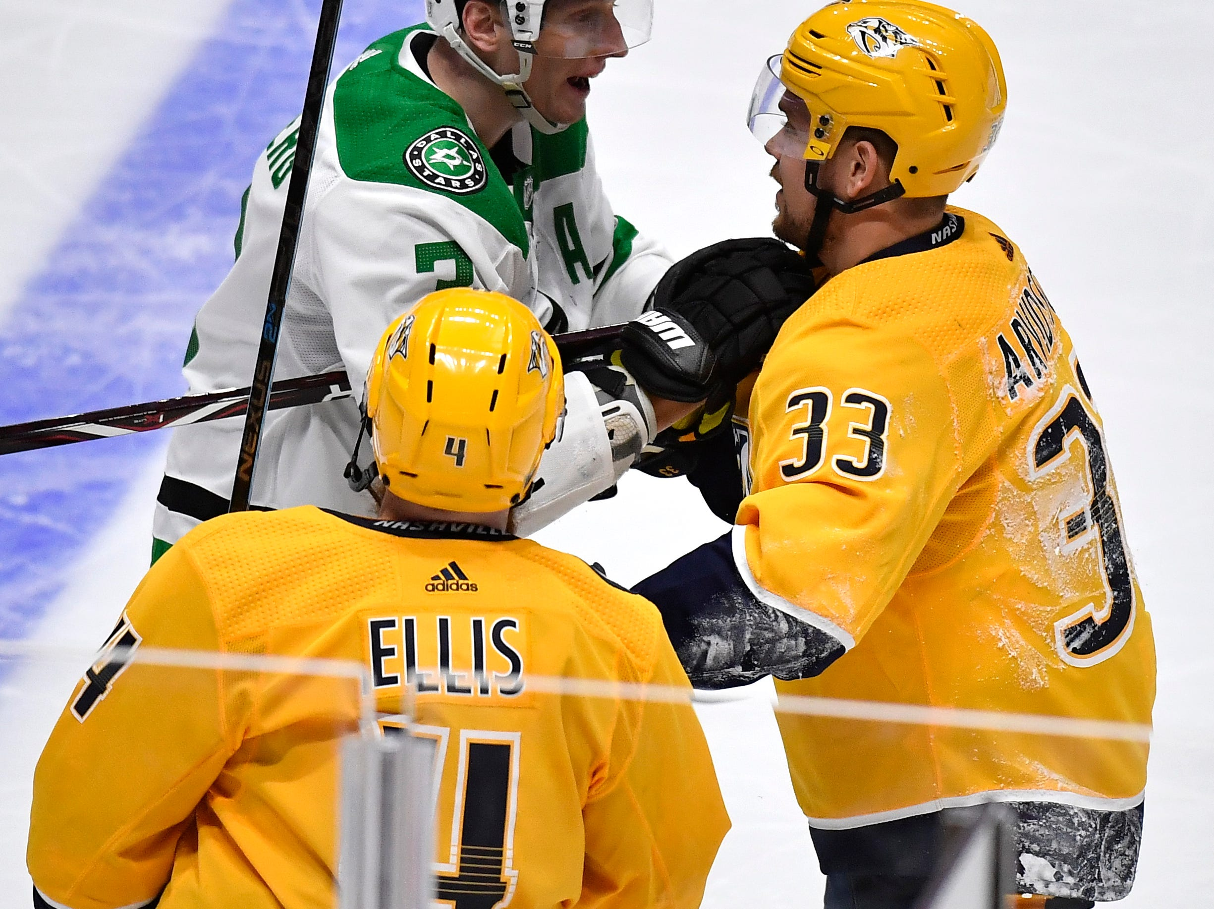 Dallas Stars defenseman John Klingberg (3) and Nashville Predators right wing Viktor Arvidsson (33) mix it up during the second period of the divisional semifinal game at Bridgestone Arena in Nashville, Tenn., Wednesday, April 10, 2019.