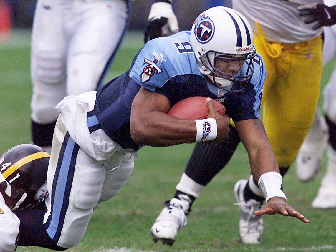 Tennessee Titans quarterback Steve McNair (9) is being tackles in their 16-10 victory over the Pittsburgh Steelers at the Adelpha Coliseum in Nashville Nov. 21, 1999.