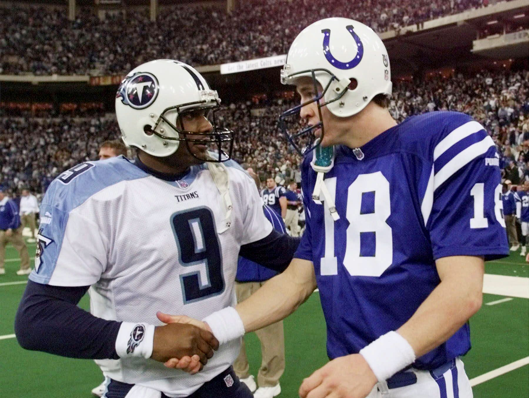 Indianapolis Colts quarterback Peyton Manning, right, congratulates Tennessee Titans quarterback Steve McNair after the Titans won their AFC divisional playoff game 19-16 in Indianapolis Jan. 16, 2000.
