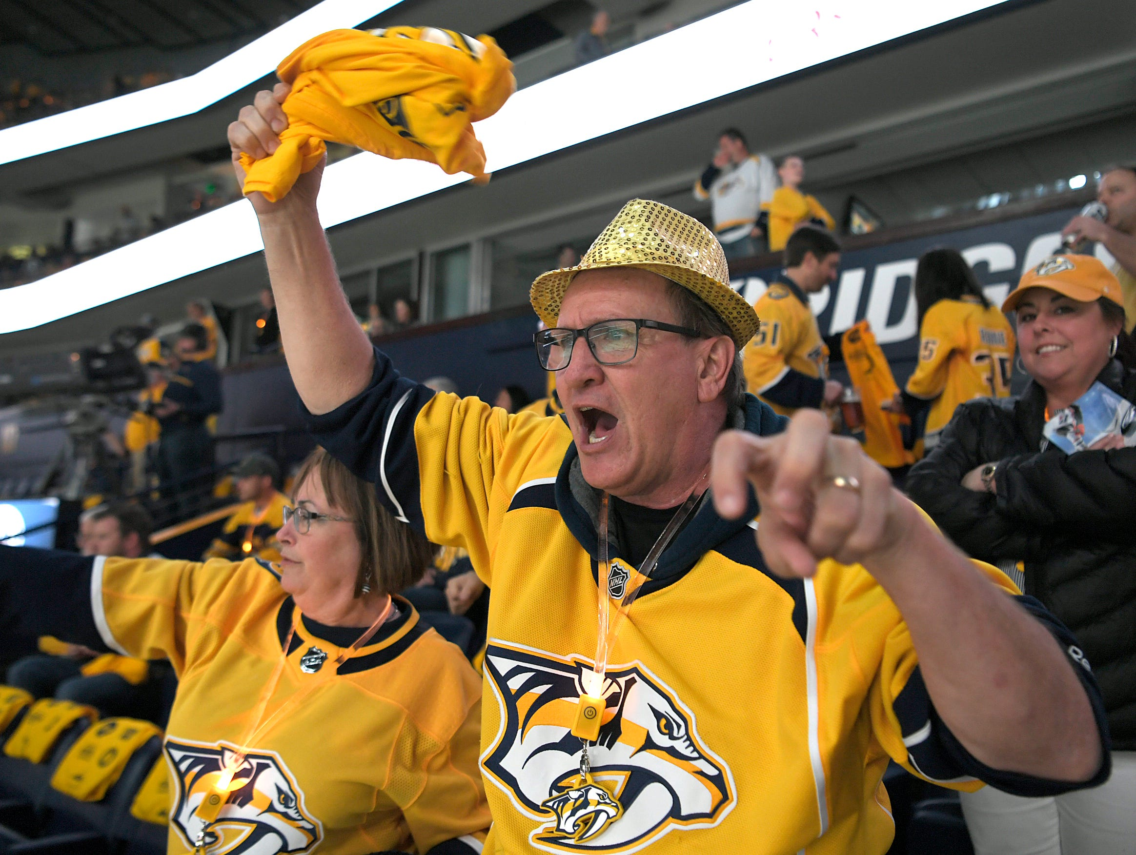 Debi and Jim Murphy of Belvidere, Tenn. cheer as the Predators take the ice during divisional semifinal Stanley Cup playoff game at Bridgestone Arena in Nashville, Wednesday, April 10, 2019.