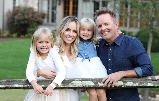 Chris Tomlin and his wife, Lauren, are parents to daughters Ashlyn, 7, left, and Madison, 4.