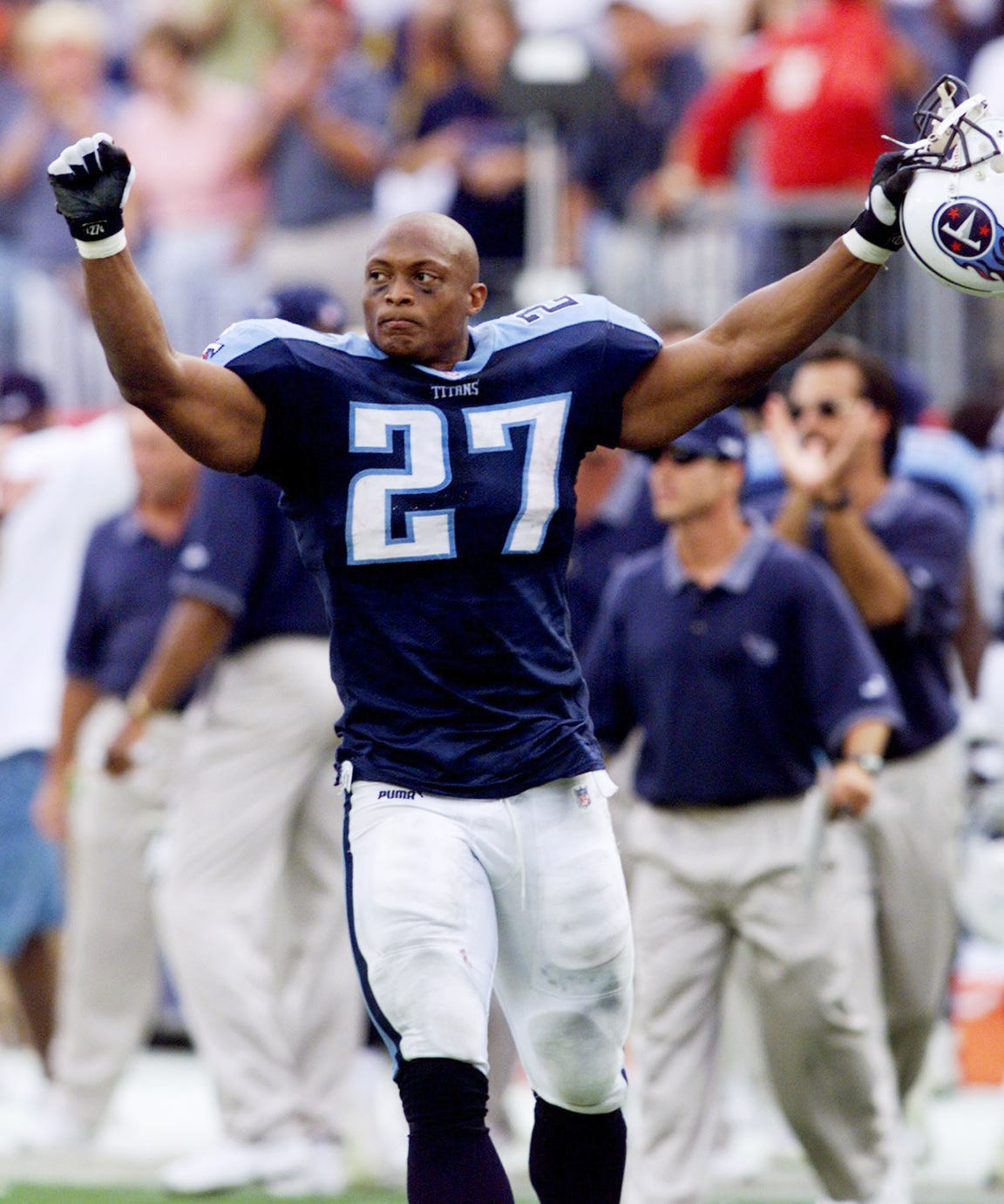 Tennessee Titans running back Eddie George holds his hands in the air after winning 24 to 21 over the St. Louis Rams at the Adelpha Coliseum in Nashville Oct. 31, 1999.