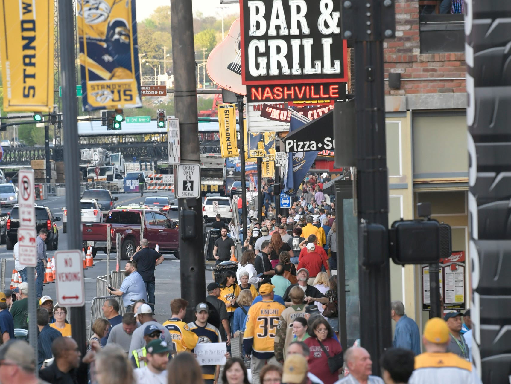 Predators fans hit Lower Broadway before the divisional semifinal game against the Dallas Stars at Bridgestone Arena in Nashville, Tenn., Wednesday, April 10, 2019.