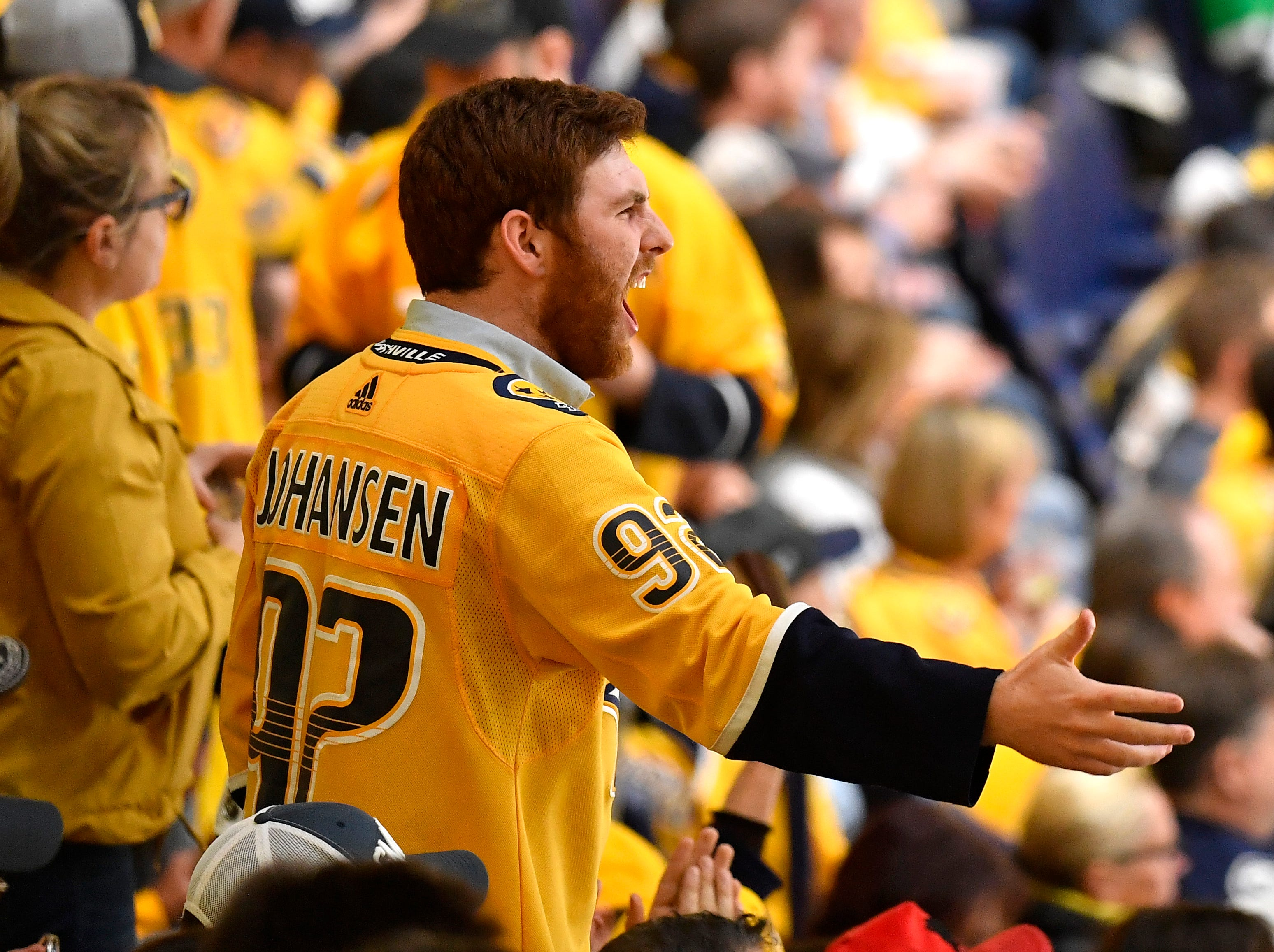 A Predators fan yells during the third period of the divisional semifinal game against the Stars at Bridgestone Arena in Nashville, Tenn., Wednesday, April 10, 2019.