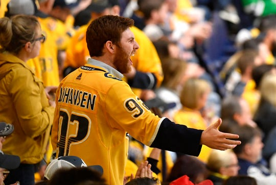 A Predators fan yells from the stands during the third period of Nashville's loss to the Dallas Stars in Game 1 of their playoff series on Wednesday. The Predators have lost five of their last six home playoff games.