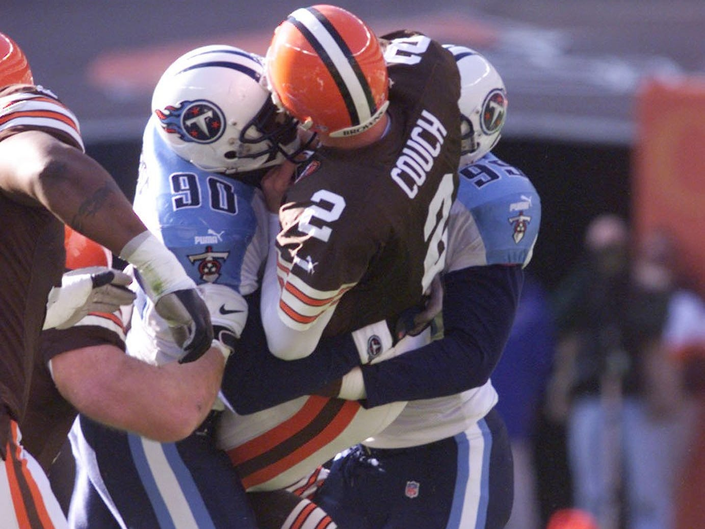 Tennessee Titans defenders Jevon Kearse, left and Kenny Holmes pick up Cleveland Browns quarterback Tim Couch and body slam him into the Cleveland Browns Stadium's turf. Titans went on to a 33-21 victory Nov. 28, 1999.