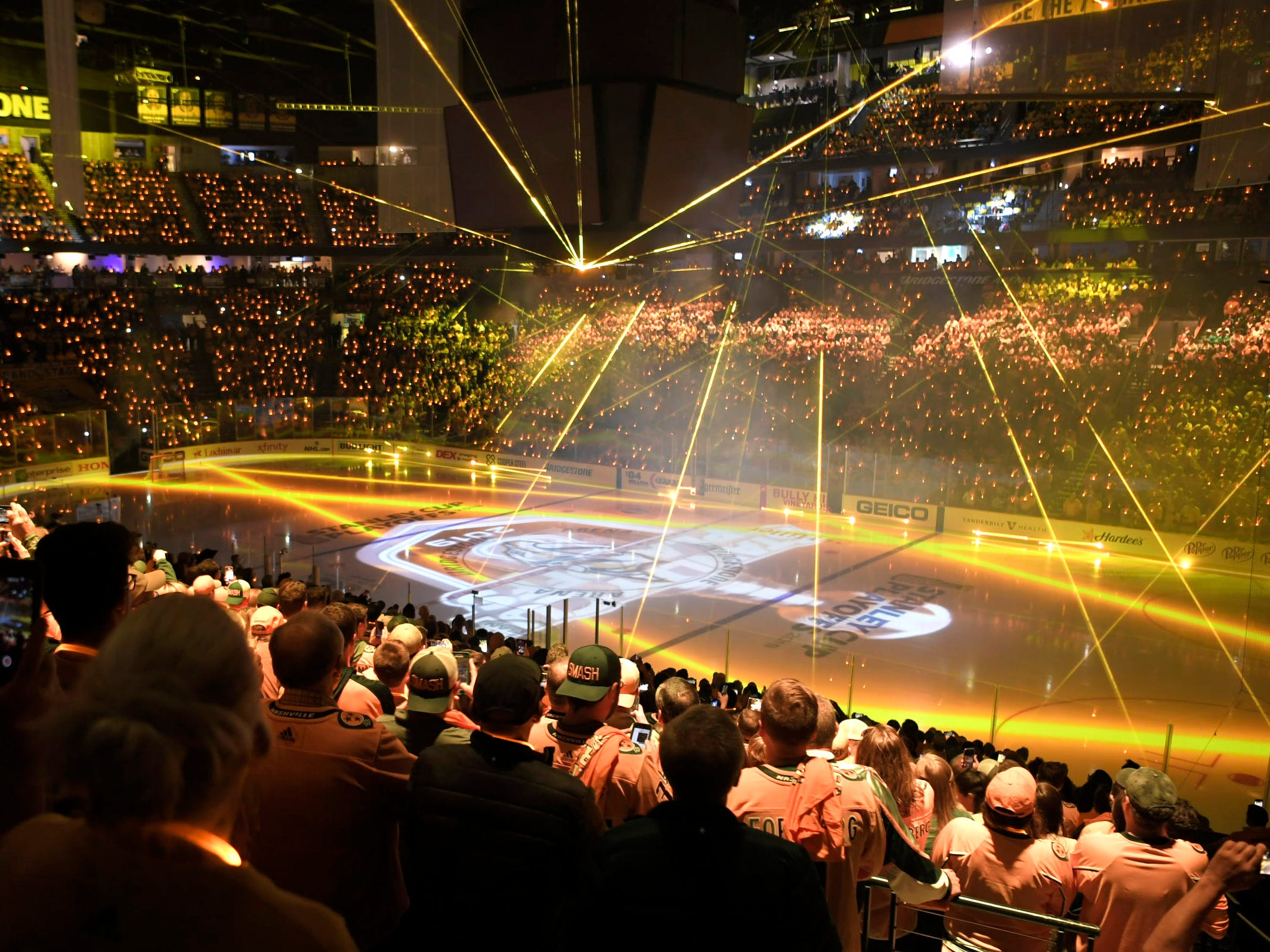 Fans wearing light lanyards light up the Bridgestone Arena before the Predators' divisional semifinal Stanley Cup playoff game at Bridgestone Arena in Nashville on Wednesday, April 10, 2019.