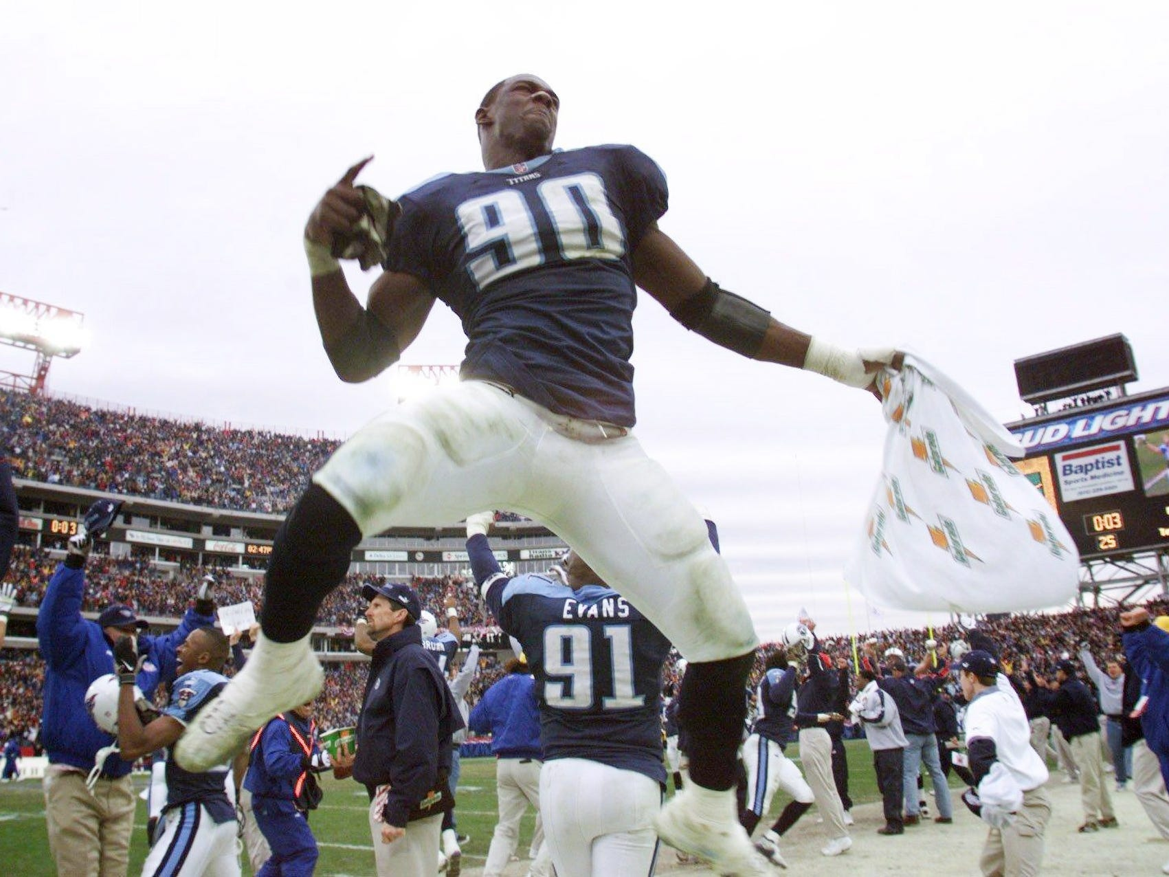 "Jevon Kearse leaps and celebrates in the air as officials ruled the Kevin Dyson kick off return was a touchdown against the Buffalo Bills Jan. 8, 2000. The Titans defended the Bills 22-16 on the last seconds ""Music City Miracle"" in the AFC Wild Card game at home."