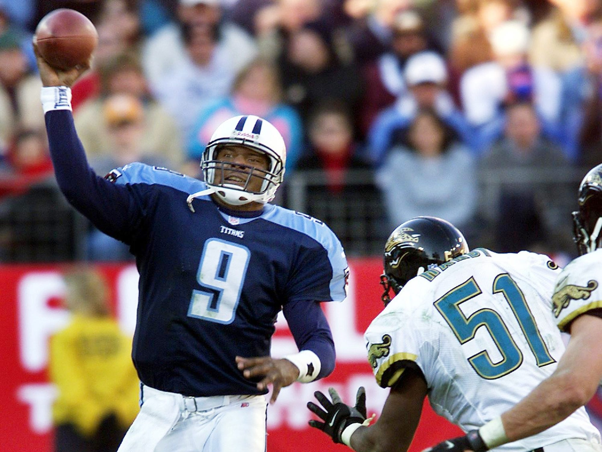 Tennessee Titans quarterback Steve McNair (9) passes over Jacksonville Jaguars defender Kevin Hardy (51) at Adelphia Coliseum Dec. 26, 1999. McNair threw for 5 touchdowns on the day before taking the bench in the 4th quarter of 41-14 victory.